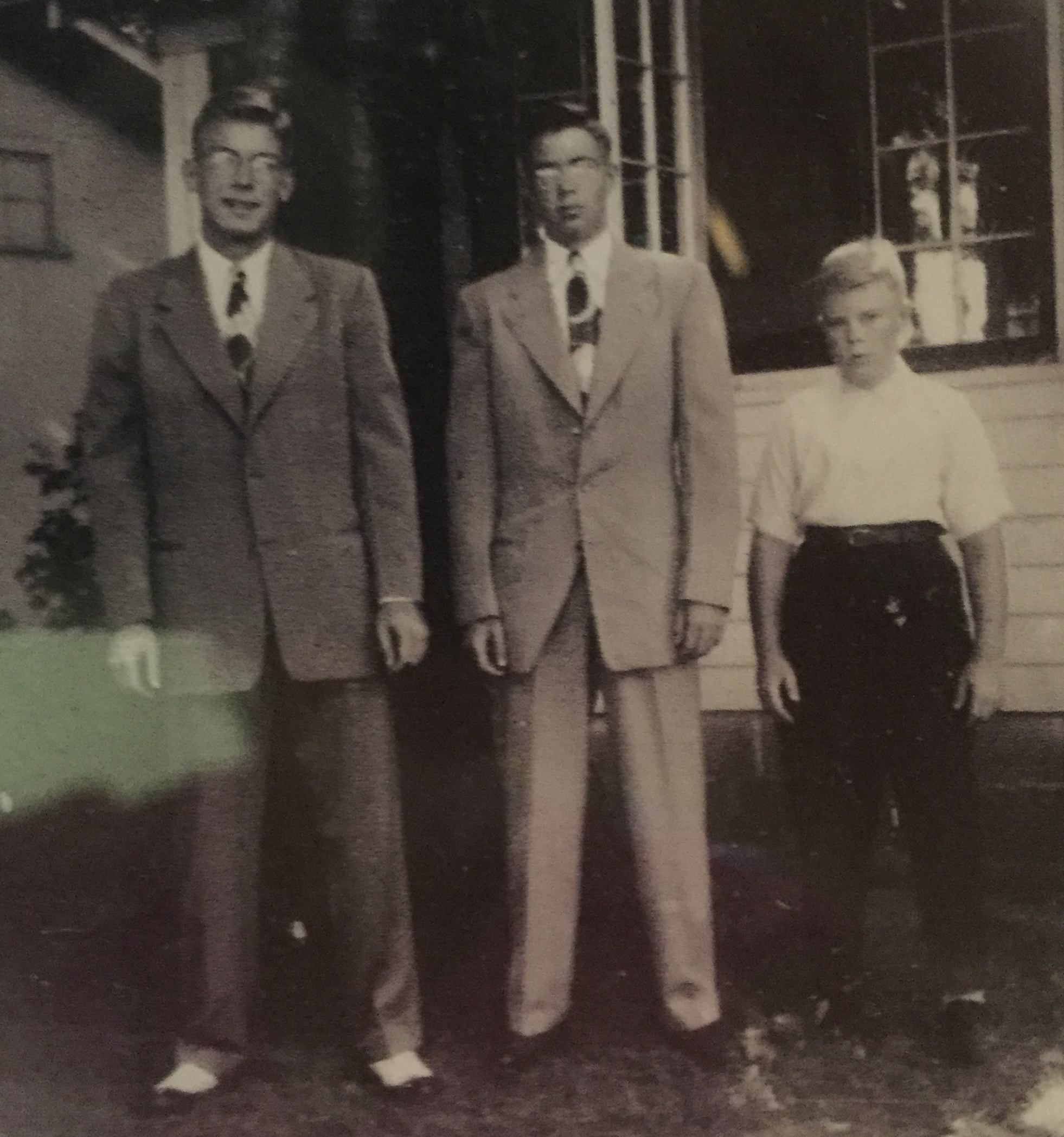 "David D. Dowd, Jr., John C. ""Jack"" Dowd, and James F. Dowd.  David and Jack are looking like some sharp-dressed men. Jim appears downright pugnacious. Family snapshot taken by David D. Dowd, Sr. or Martha Combrink Dowd, late 1940s. Shady Shores Resort, Dowagiac, Michigan. My cousin Deb Clinebell (née Dowd, daughter to Jim and Betty) sent this to me yesterday via a text message. I think she re-photographed a snapshot in an album."