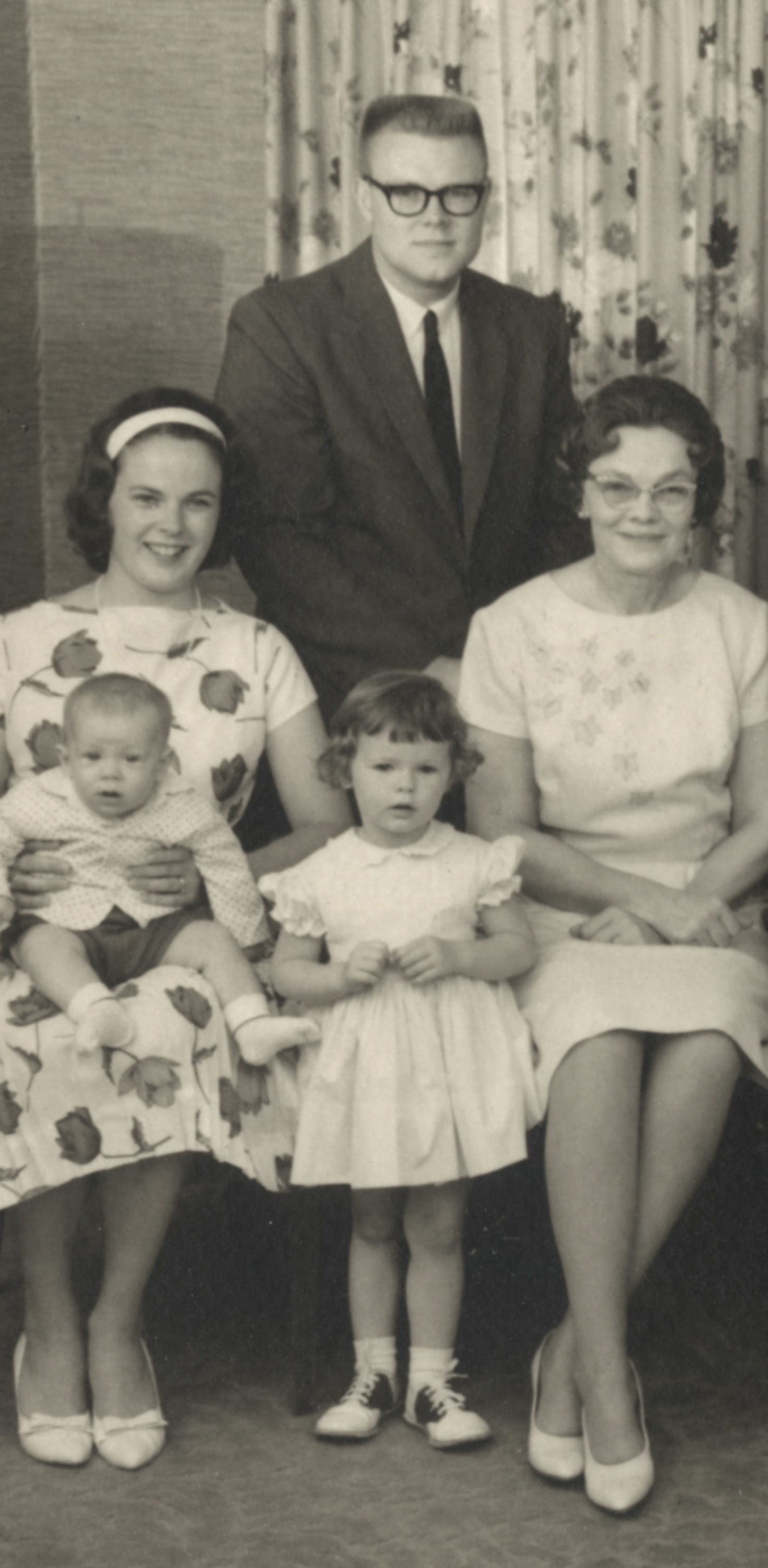"""Jim Dowd, in the back; Betty Dowd with Ken Dowd in her lap;Debbie Dowd (now Clinebell) standing center; Martha Combrink Dowd (Jim's mother, my grandmother) at right. This is a detail from a much larger family photograph shot at 1021 Oxford in 1965. That conservative-looking guy in the back was a freedom rider in the South and on the scene for the March on Washington. He heard Martin Luther King Jr.'s """"I Have a Dream"""" speech live. (The audio was garbled and difficult to follow.)"""
