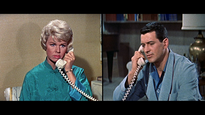 Finally, even a split screen in a film is a kind of display. Here, Doris Day and Rock Hudson in  Pillow Talk , 1959. Directed by Michael Gordon. Hudson, (unknown to the movie-going public) a gay man, plays a smoothie-lothario who pretends to be gay at points. Jean Louis did Doris Day's costumes, which are incredible.