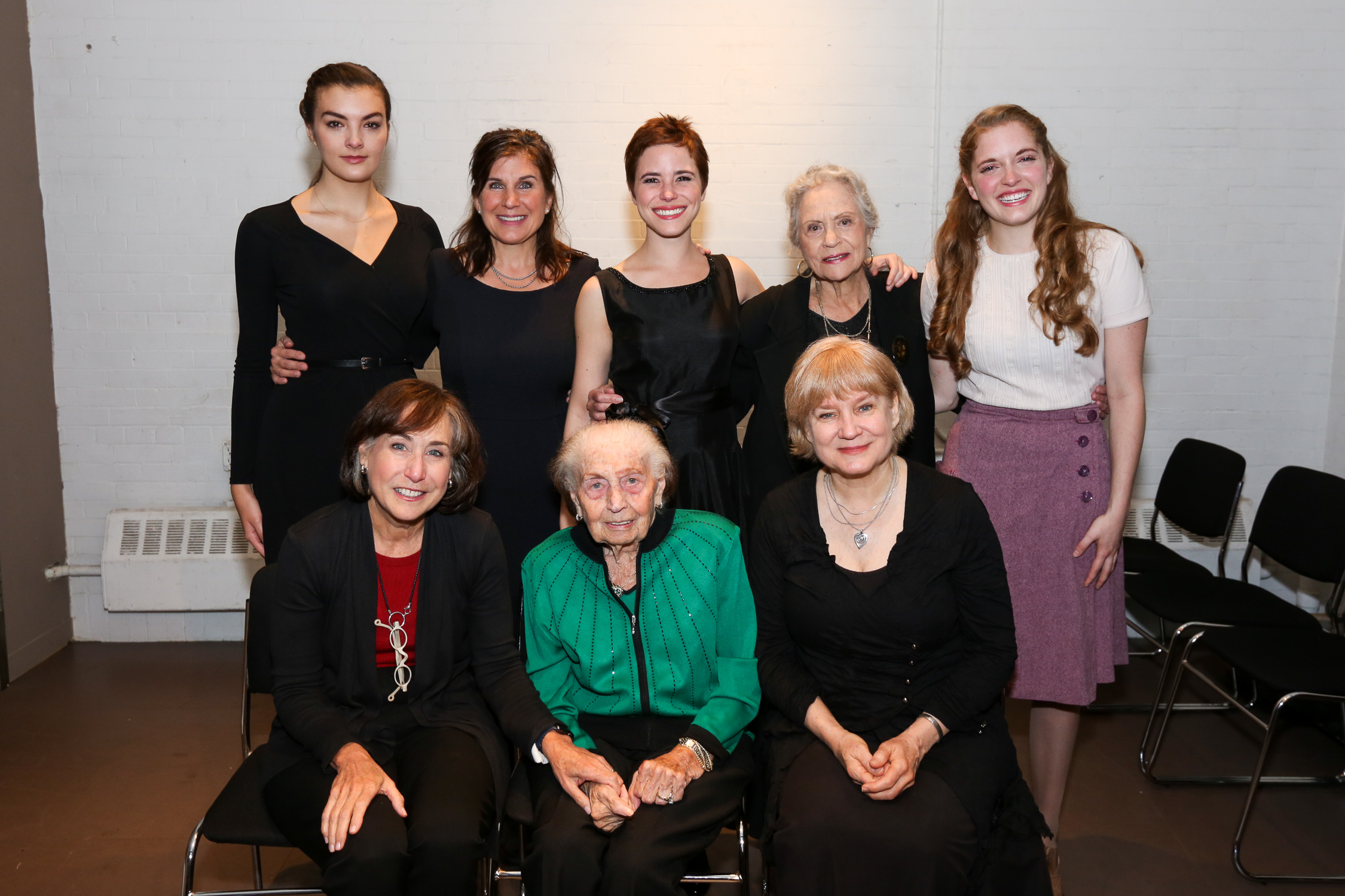 """Pictured above are members of the cast (Britian, second row, far right) along with the playwright (Arlene Hutton, first row, far right) and the actual Sala Garncarz Kirschner (first row, middle) with her daughter, Ann Kirschner (first row, far left) the writer of """"Sala's Gift"""", the book that inspired the play."""
