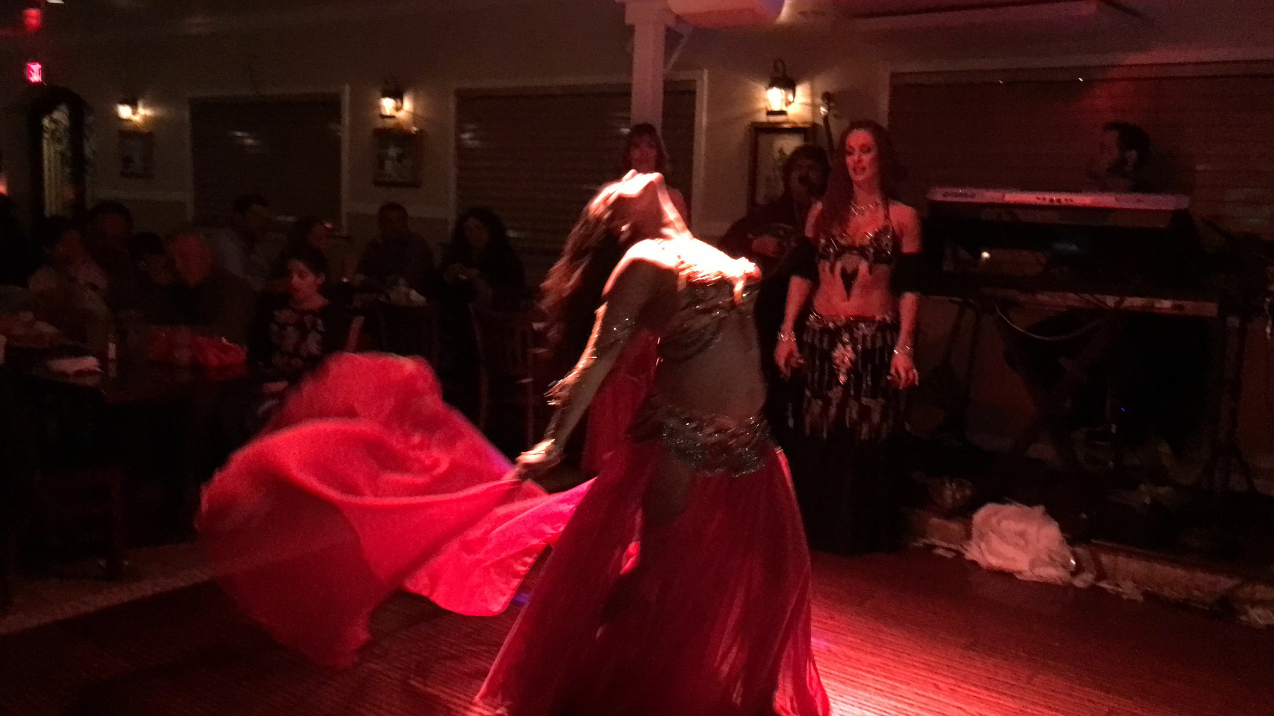 Bellydance with red veil zorbas.jpg