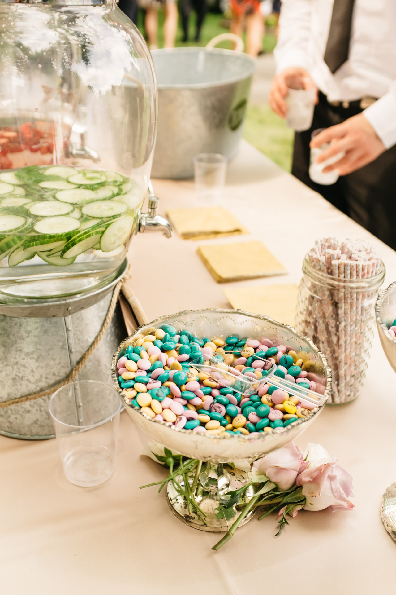 "Say ""I do"" in the yummiest way!  Customized M&M's (here we did photos of the bride and groom as well as their initials) is   the tastiest idea for personalized wedding favors and colorful custom snacks at your drink stations.  Photo:  Micheal Beaulieu   M&M's:  M&M's"