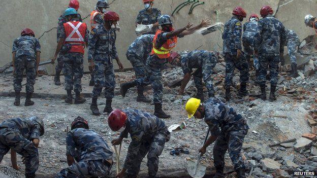 Rescuers work amid the latest quake damage in Kathmandu. (Photo source - Reuters)