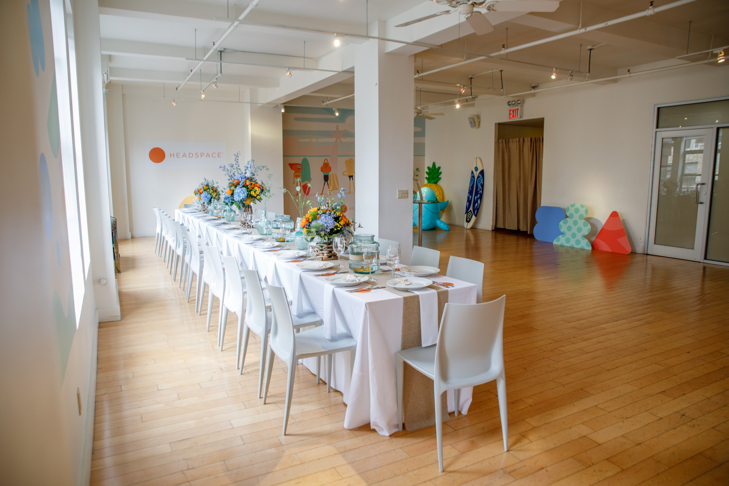 Surf's up! A beach-themed luncheon hosted by Headspace with customized walls and props.