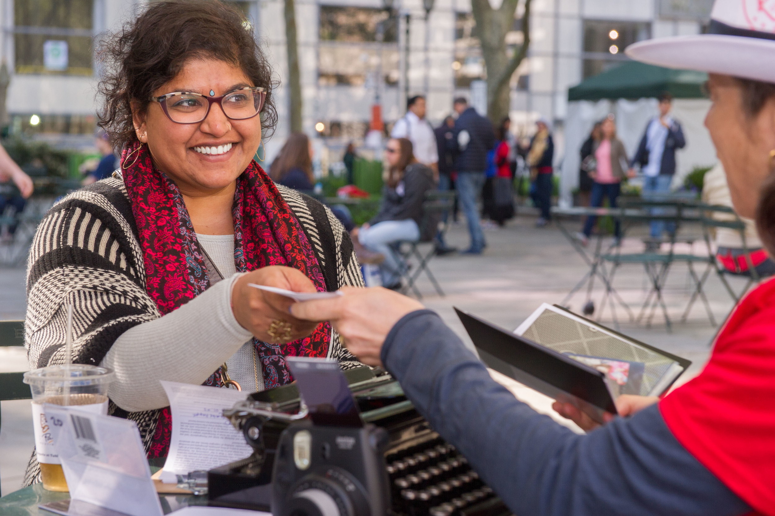 Sheetal Prajapati dictated a message at Bryant Park. Photo by Christian Carter-Ross.