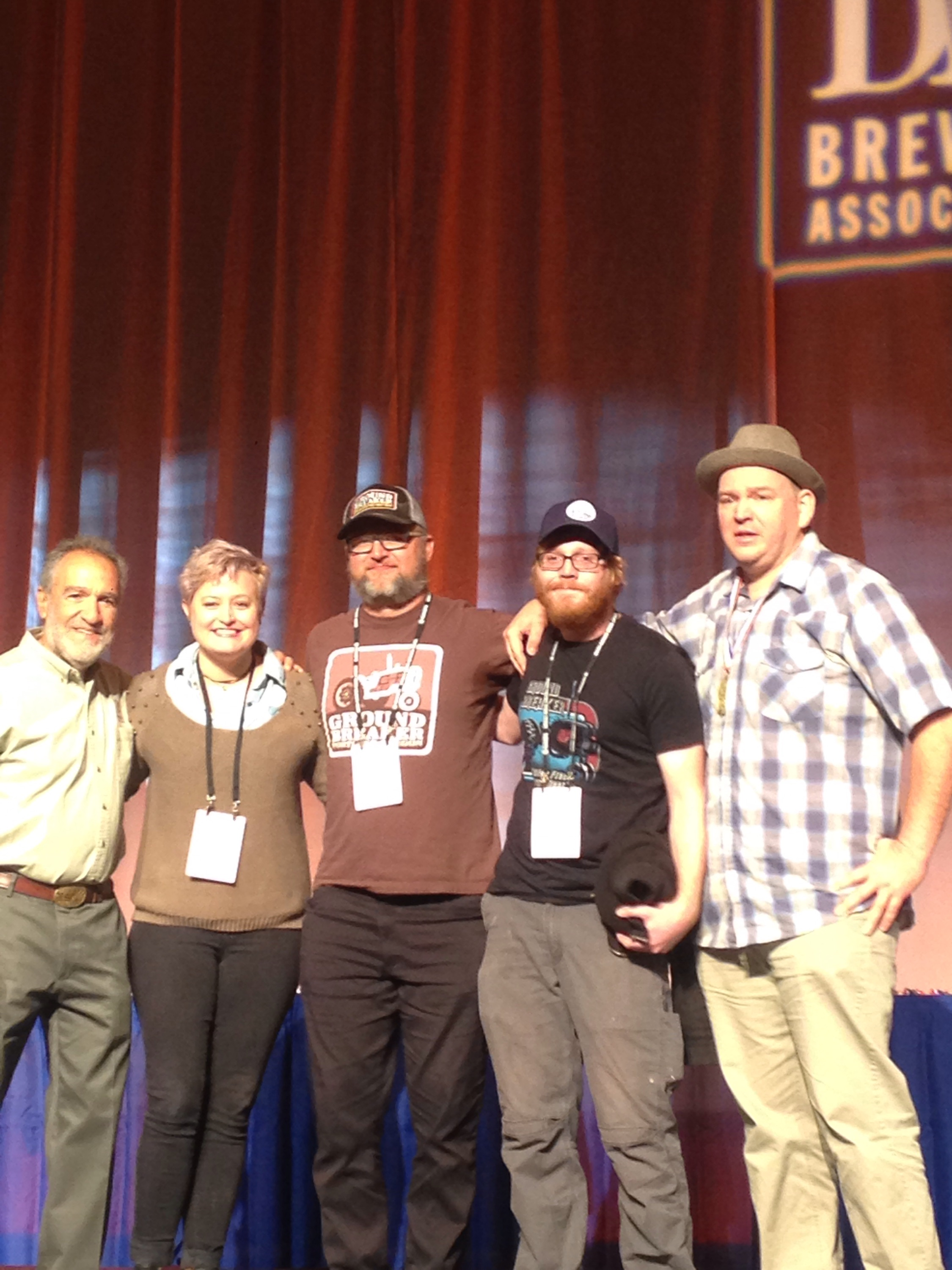 Ground Breaker Brewing accepts the GABF Gold Medal for Gluten-Free Beer from Charlie Papazian. From left to right: Charlie Papazian, Maddy McCarthy (cellarwoman), Paxton Scott (head of sales), Tyler Kueber (head brewer), and James Neumeister (founder).