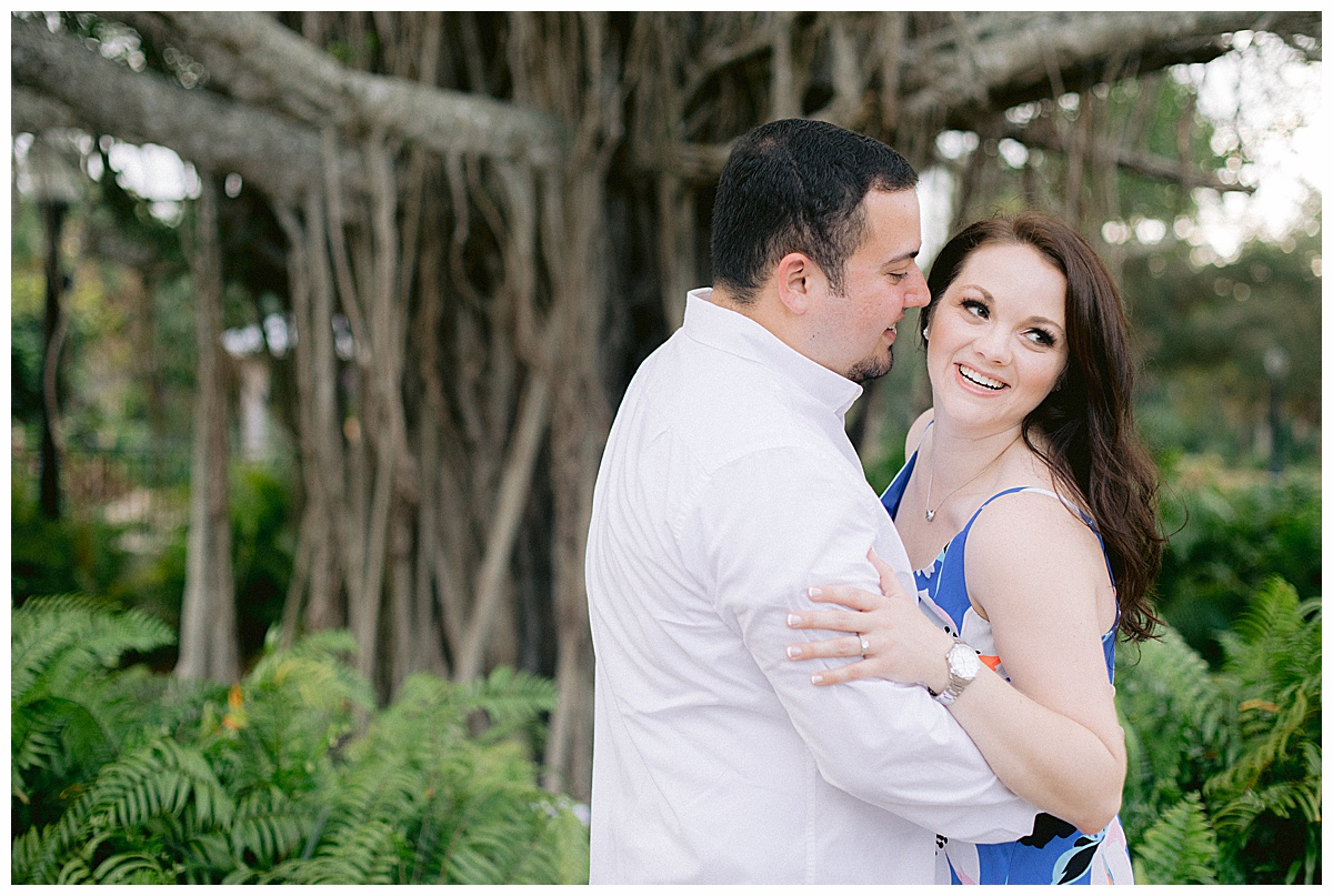 Engaged couple poses for photos in Stuart FL