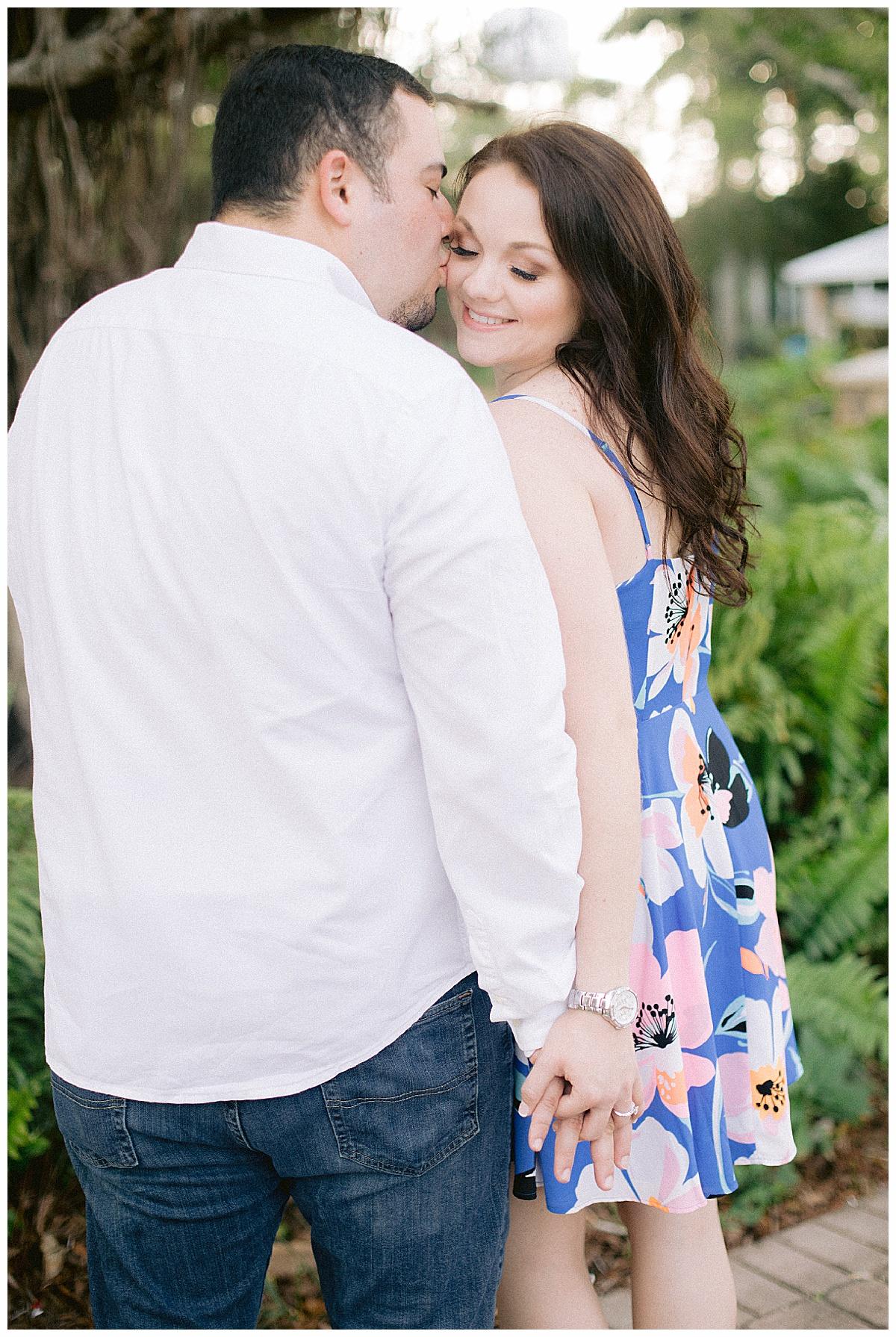 Kissing his fiance on the cheek | Stuart Fl
