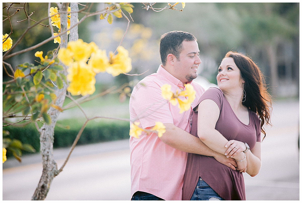 Yellow blossoms in downtown Stuart make for a great engagement photo