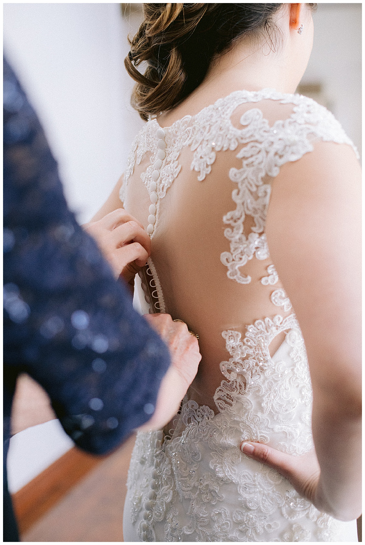 Tradition Town Hall wedding buttons on back of bride's dress