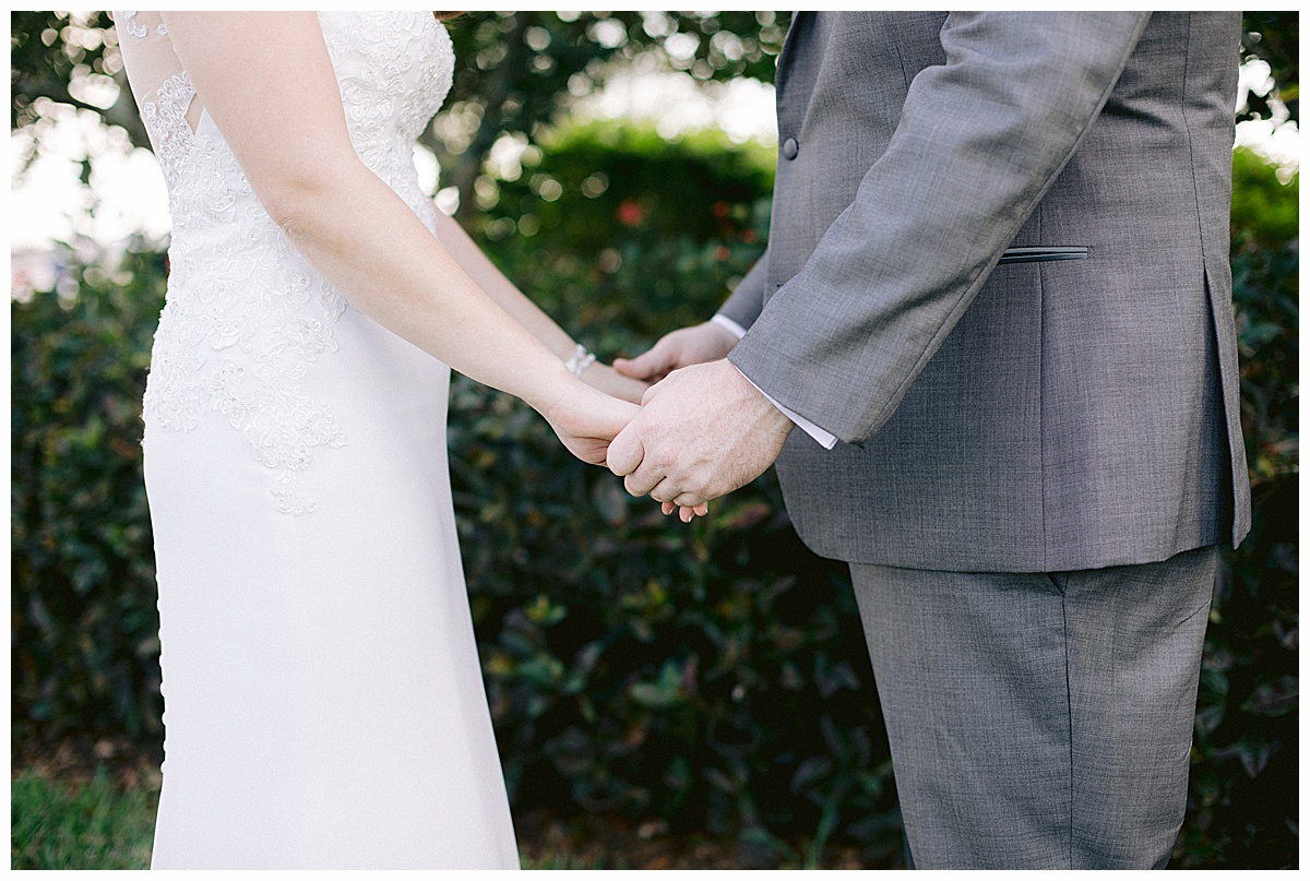 bride and groom holding hands at Tradition Town Hall