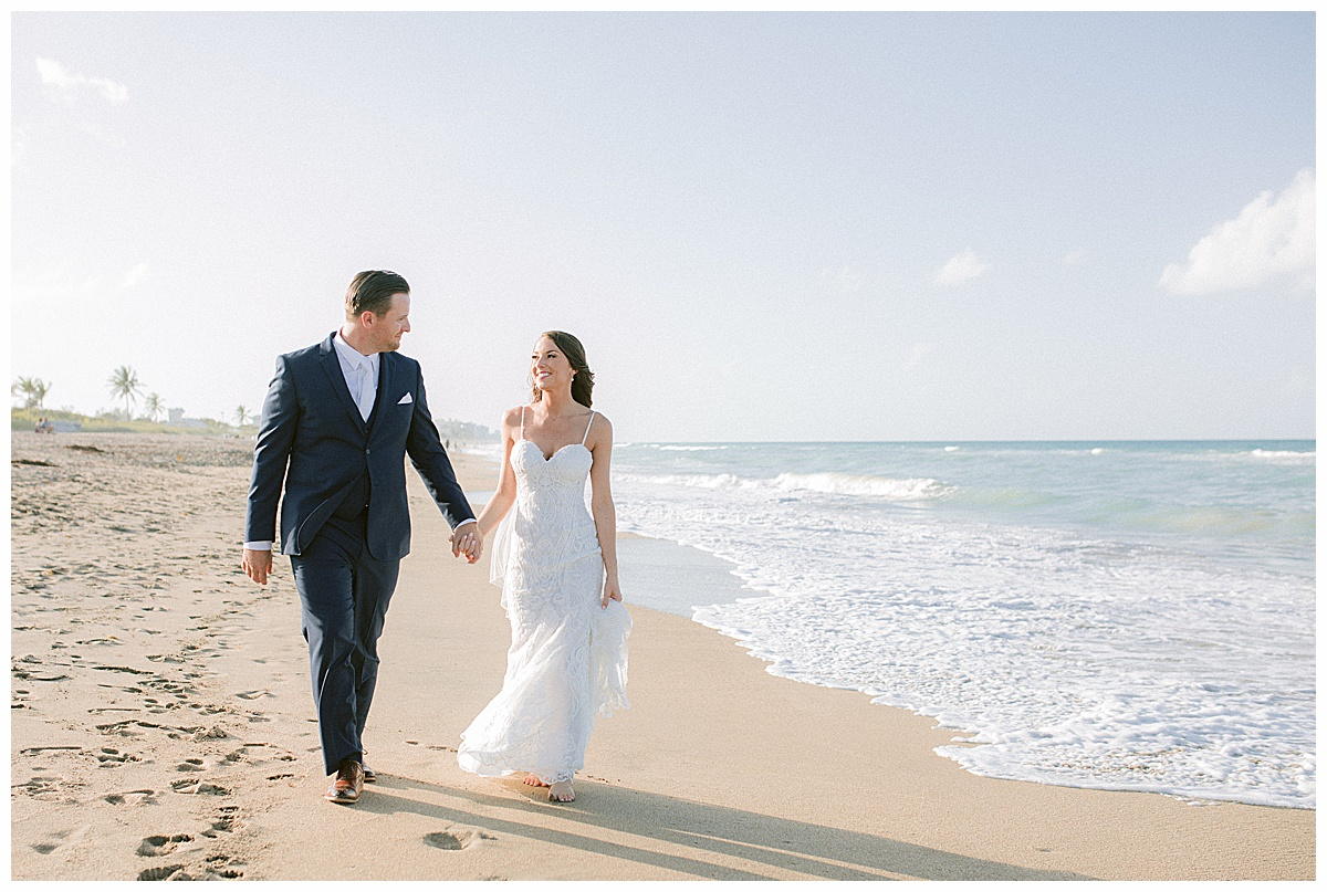 Bride and Groom walking on the beach at Hutchinson Shores Resort and Spa