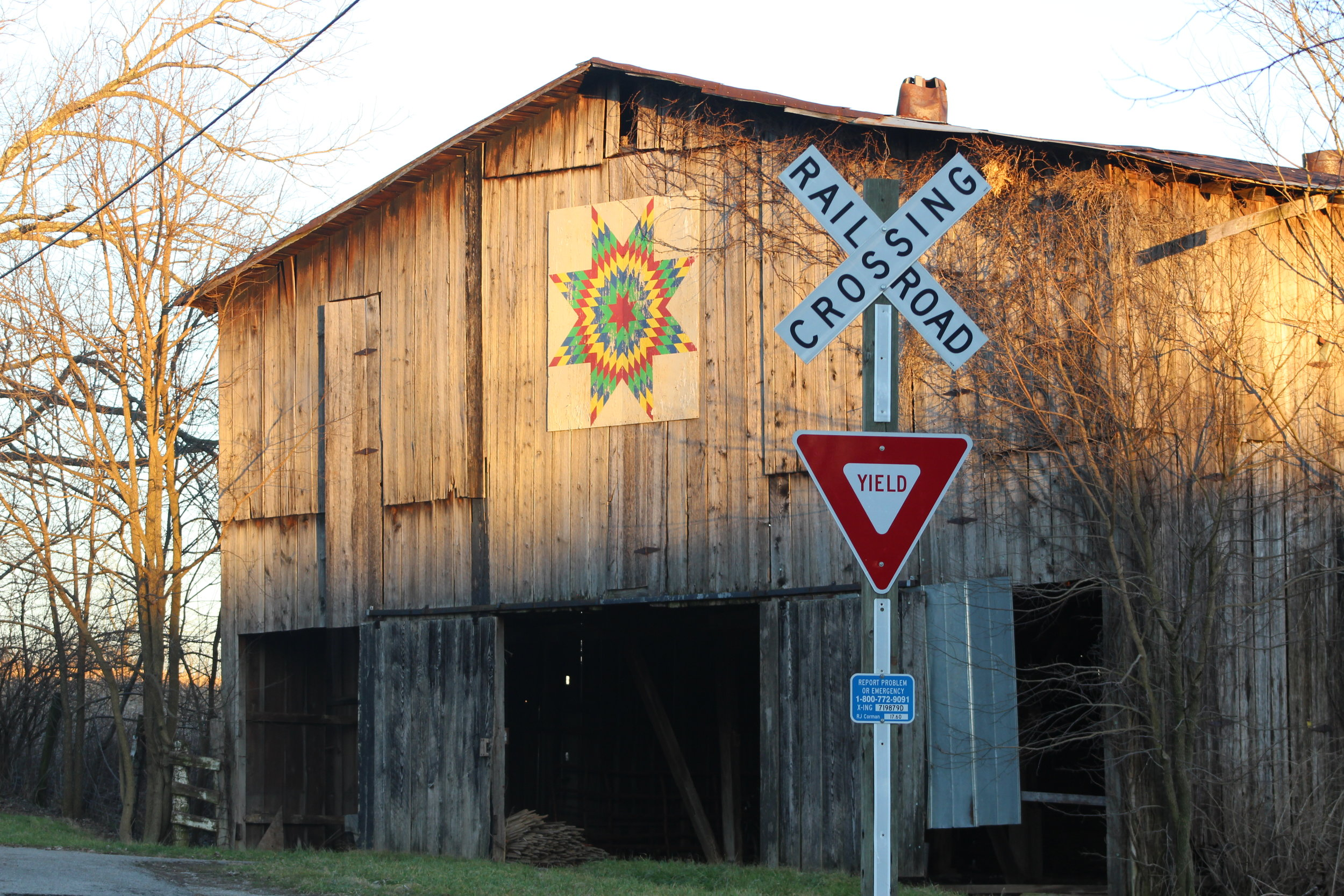Barn, featuring a Kentucky quilt, opposite the chicken house and next to the railway.