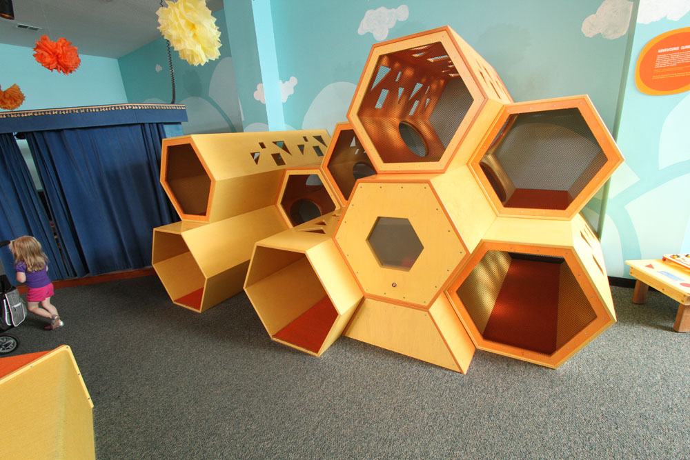 HONEYCOMB CLIMBER  Unique structure shaped like a honeycomb. Created especially for you to crawl and climb around in. Go to the peek-a-boo window to be surprised.   Sponsored by The David Johns Family