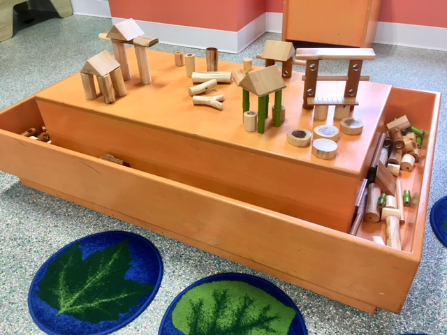 NATURE BLOCK TABLE  Smooth logs, bamboo planks and dowels inspire building play with natural materials.   Sponsored by Don Sesslar and Dawn Shonk.