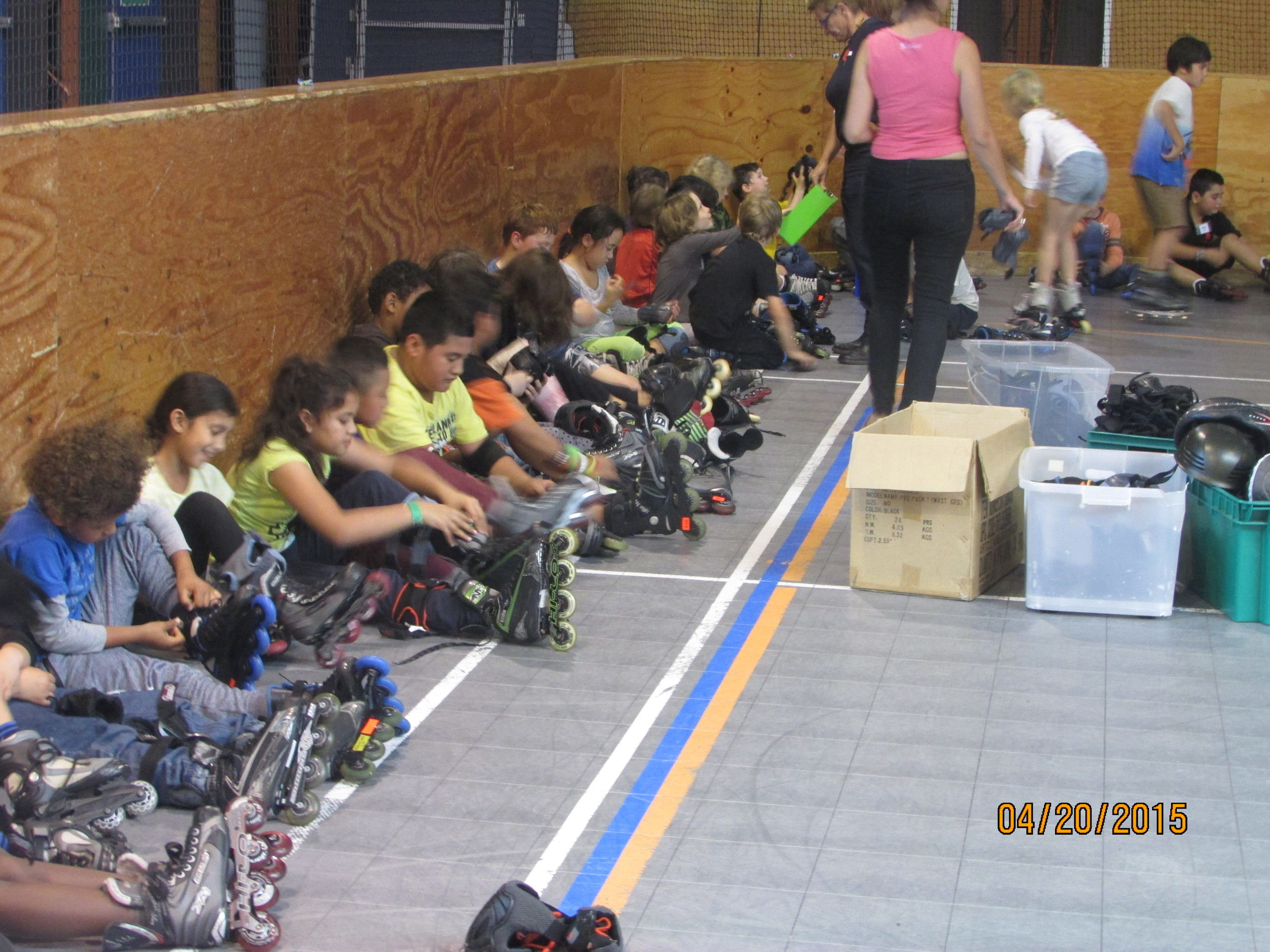 Te Aro School children learning to correctly put on their skates and safety gear.