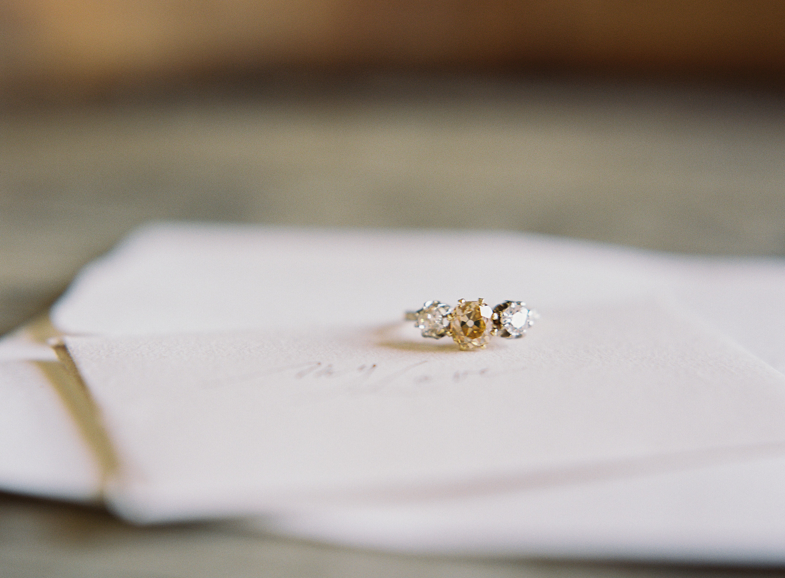 A white and yellow diamond vintage ring from Trumpet and Horn | follow us on Instagram @thewildflowers.events