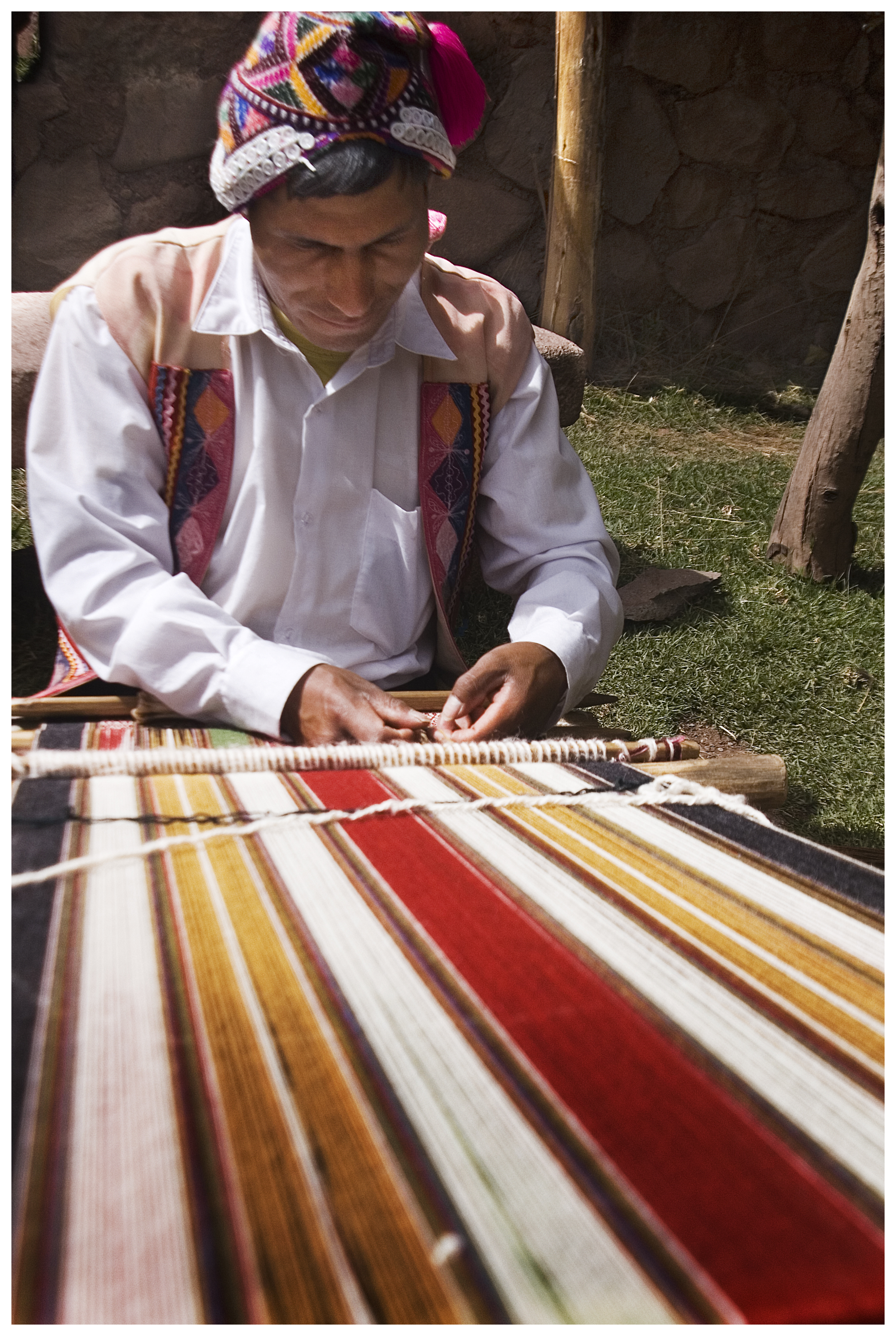 An artisan weaver works on a blanket at the Camelids, which will eventually be sold to a very lucky tourist.