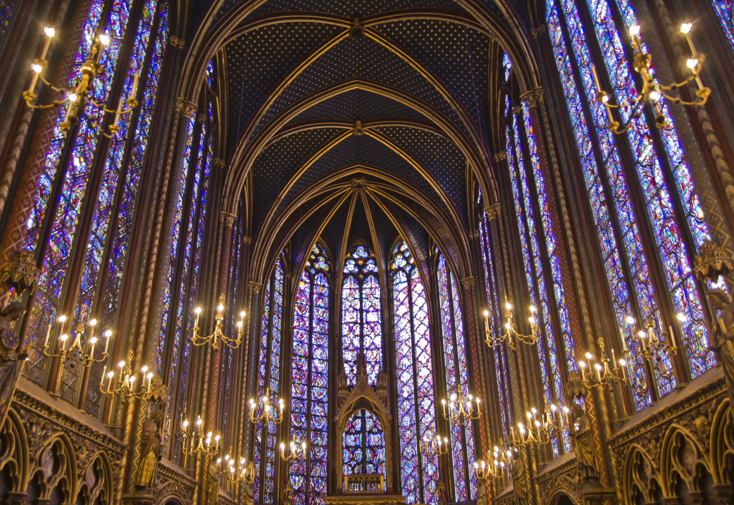"The walls of the upper chapel of Sainte Chapelle is almost completely lined with stained glass windows, thus giving it the common name of ""The Glass Chapel"".  This is one of my must see places in Paris and is a wonderful place to experience some introspective, meditative time."