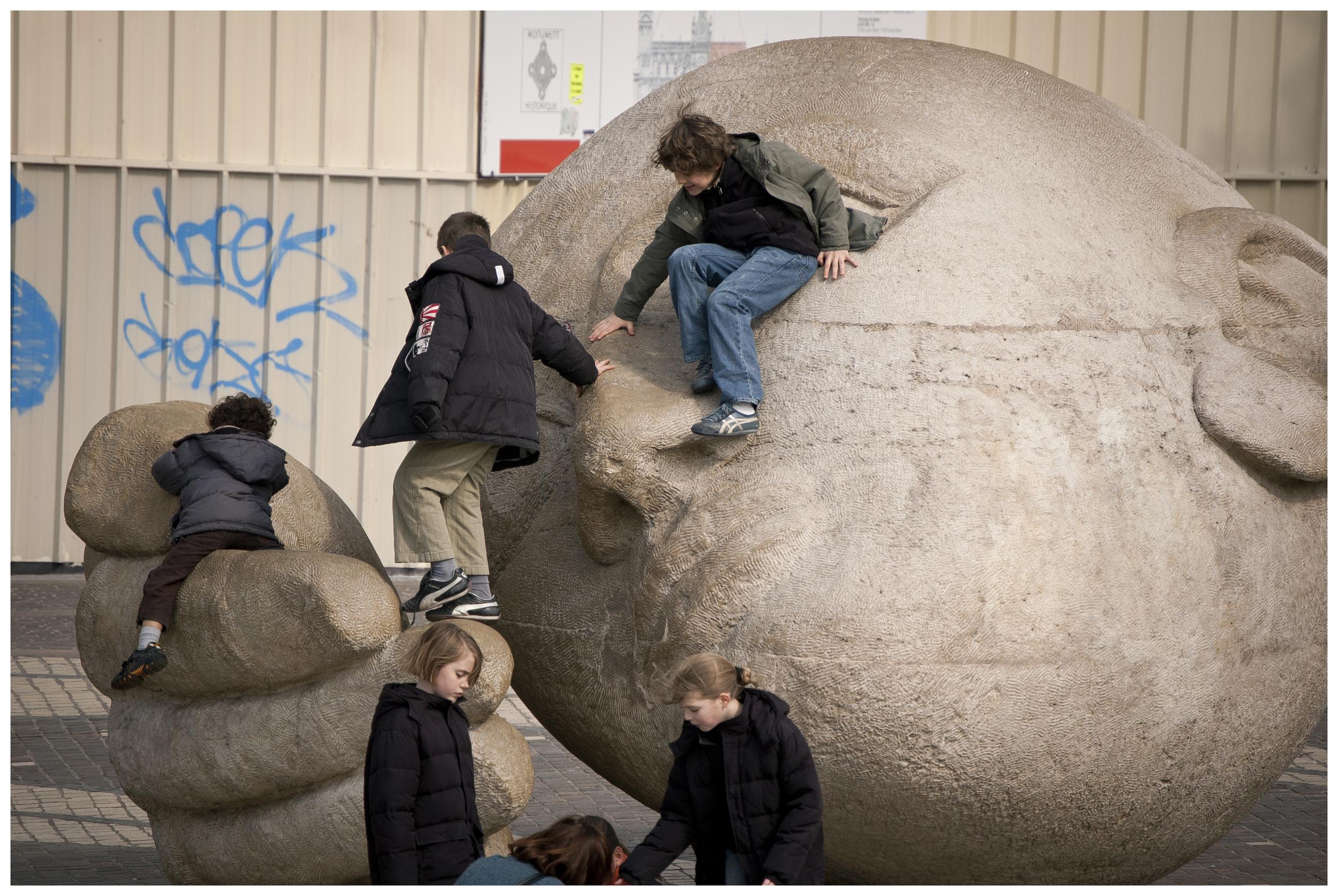 Children at play in a public park/sculpture garden.