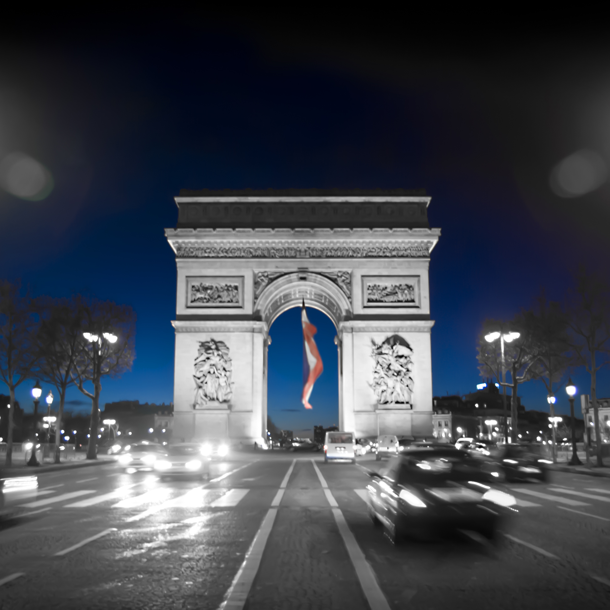On my final night in paris, I was on   Les  Champs - Elysées  creating long exposures of the  Arc  de  Triomphe.
