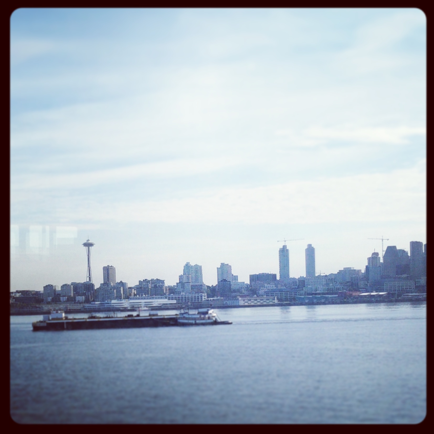 Photo Cred: romp Community [view of Seattle from Seattle-Bainbridge ferry]