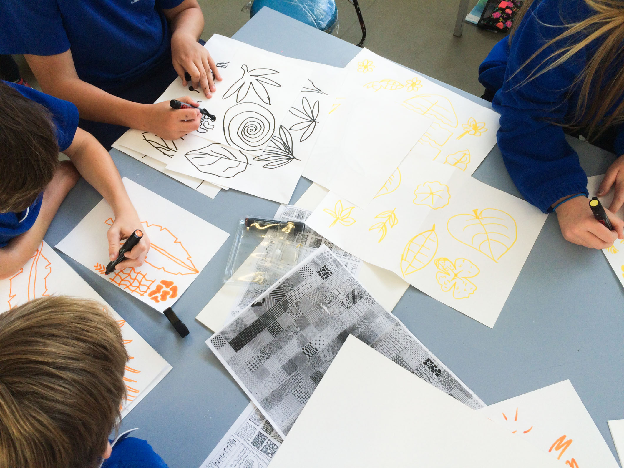 Students producing sketches and planning their mural.