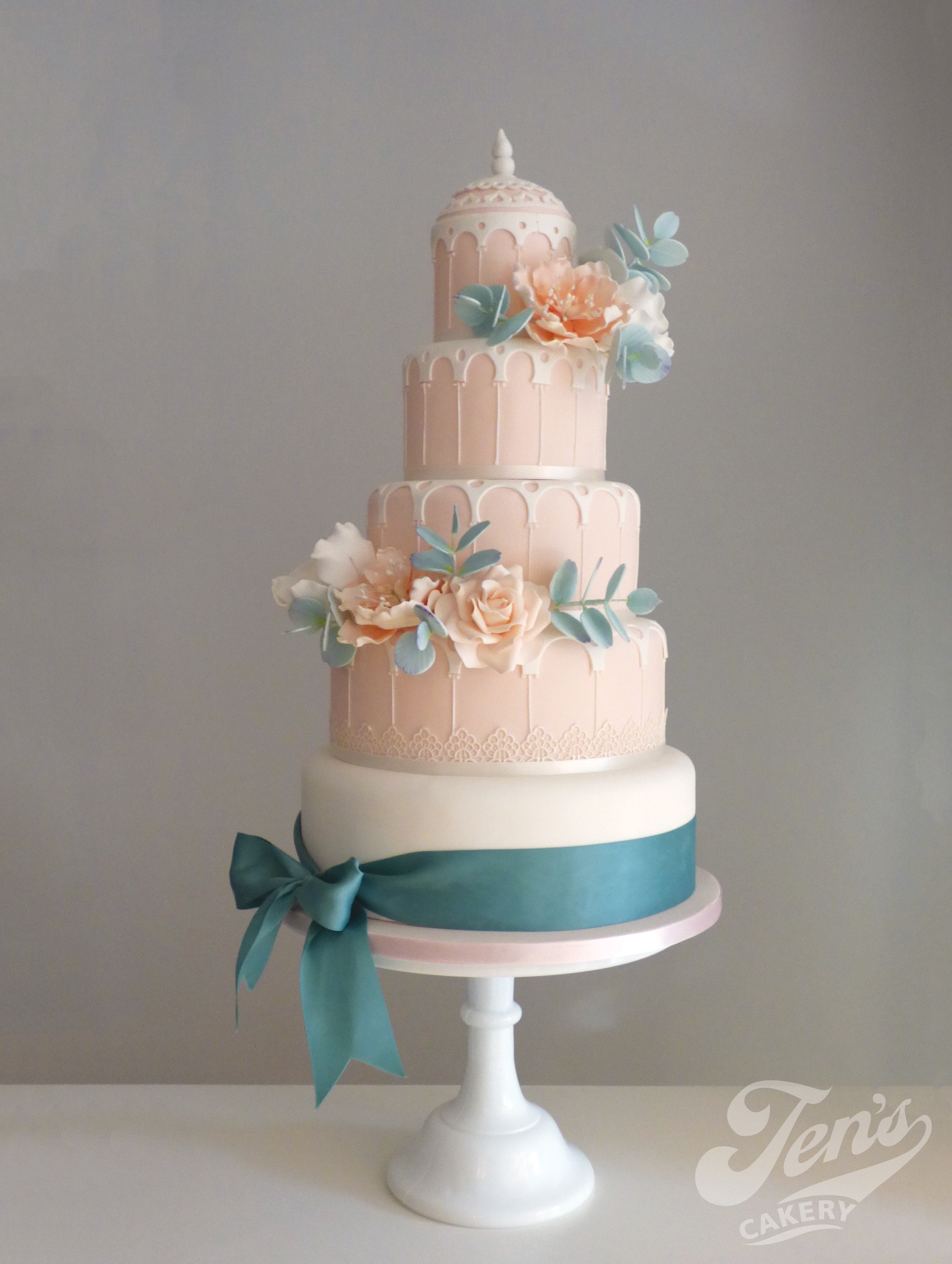 Elegant blush and eucalyptus version of Maya, a wedding cake based on Syon Park Great Conservatory