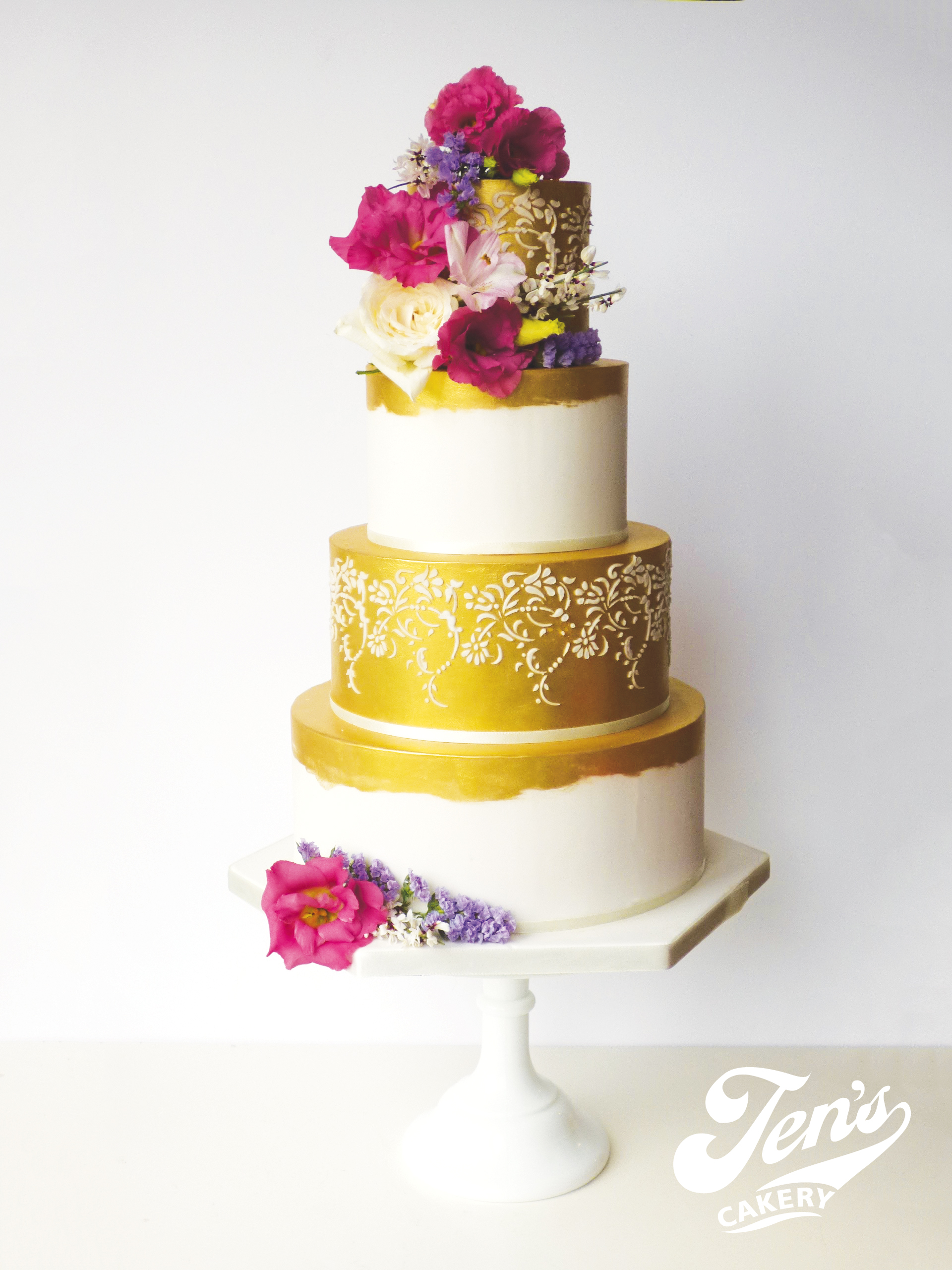 A wedding cake with metallic gold lustre and lace details - this is a great budget option with a luxury feel.
