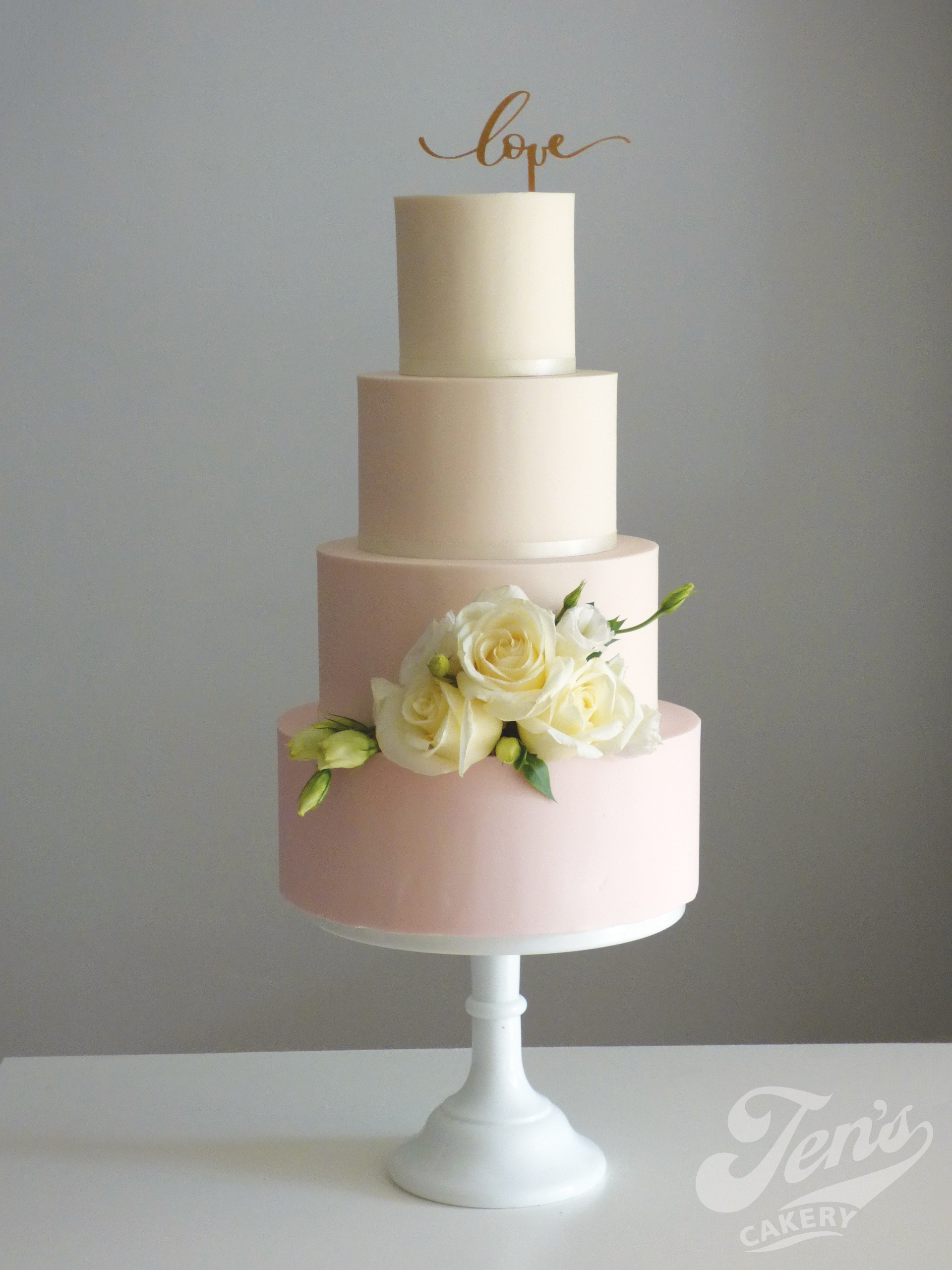 Beautifully simple, an ombre wedding cake in blush. Keeping it simple means it's easy on the budget too!