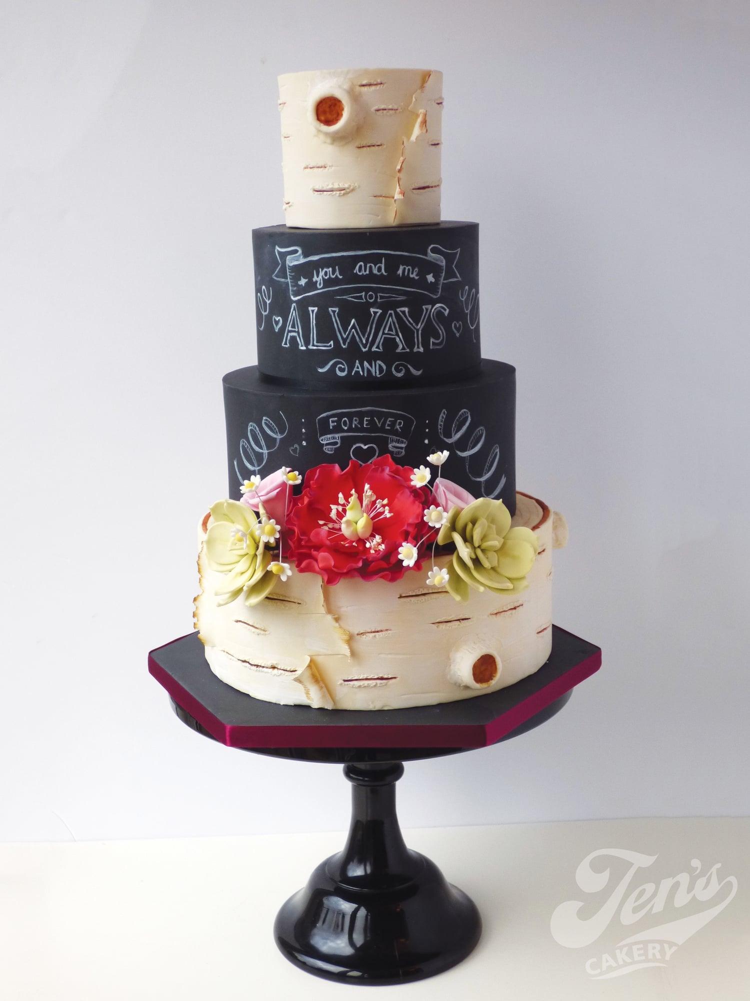 Wedding cake with silver birch tree bark and slate chalkboard art.