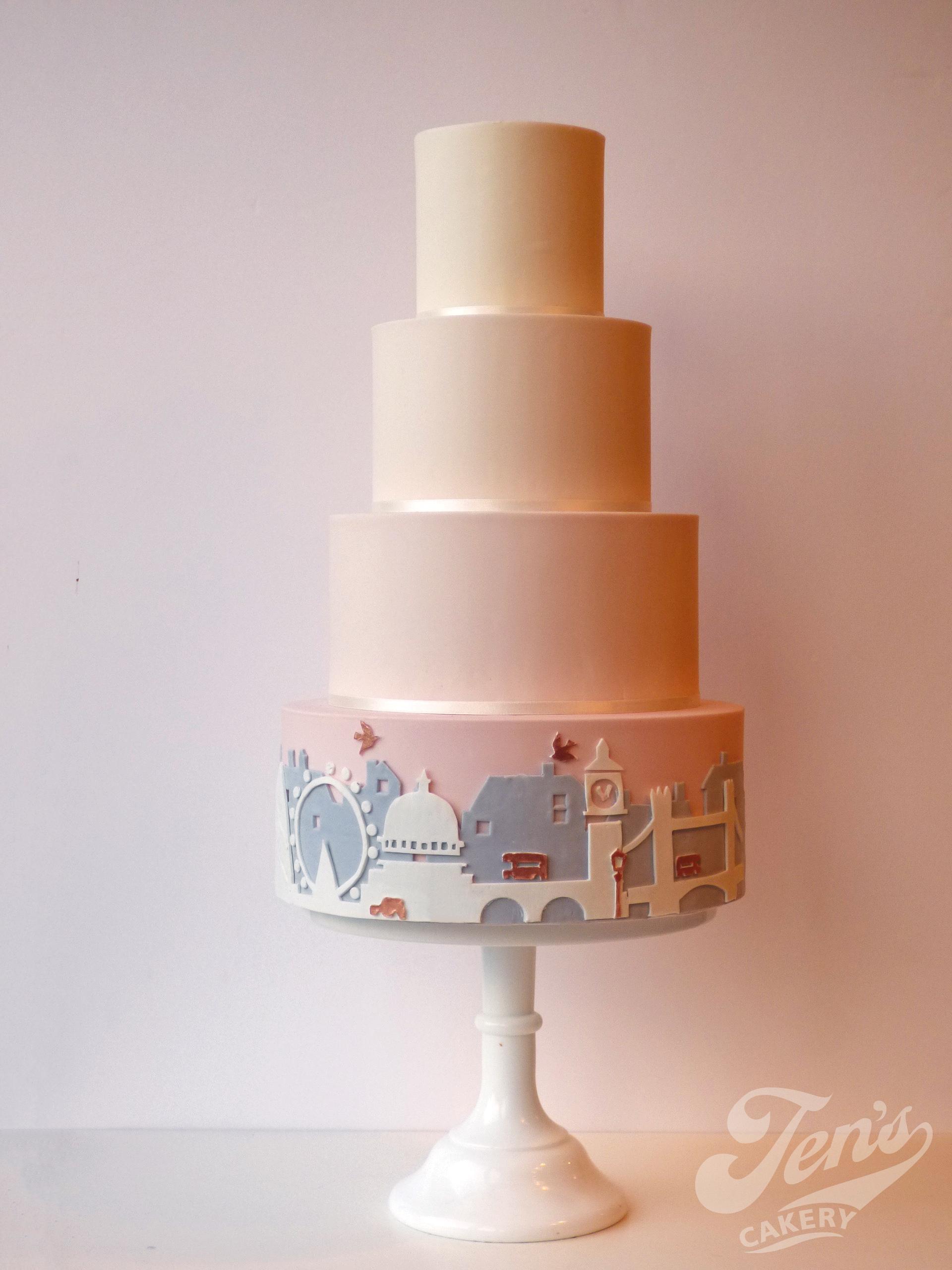 London skyline wedding cake in blush and rose gold.