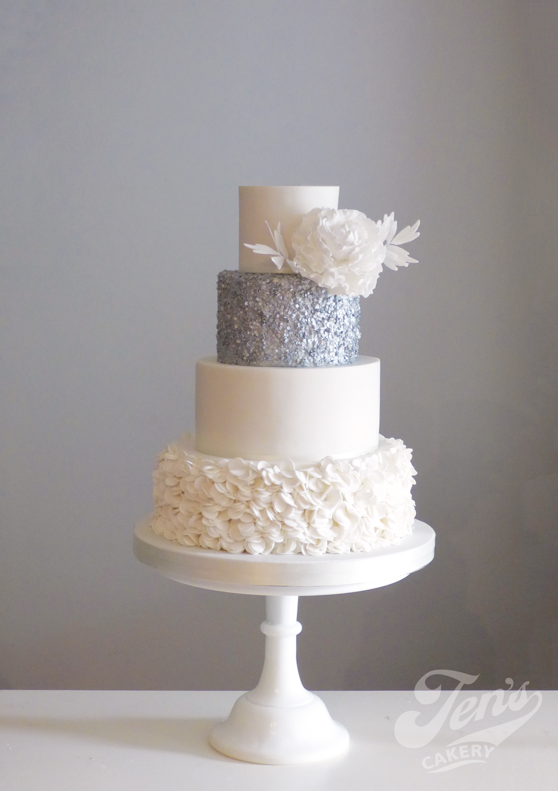 Wedding cake with frills and sequins and a sugar peony at Chiswick House in London