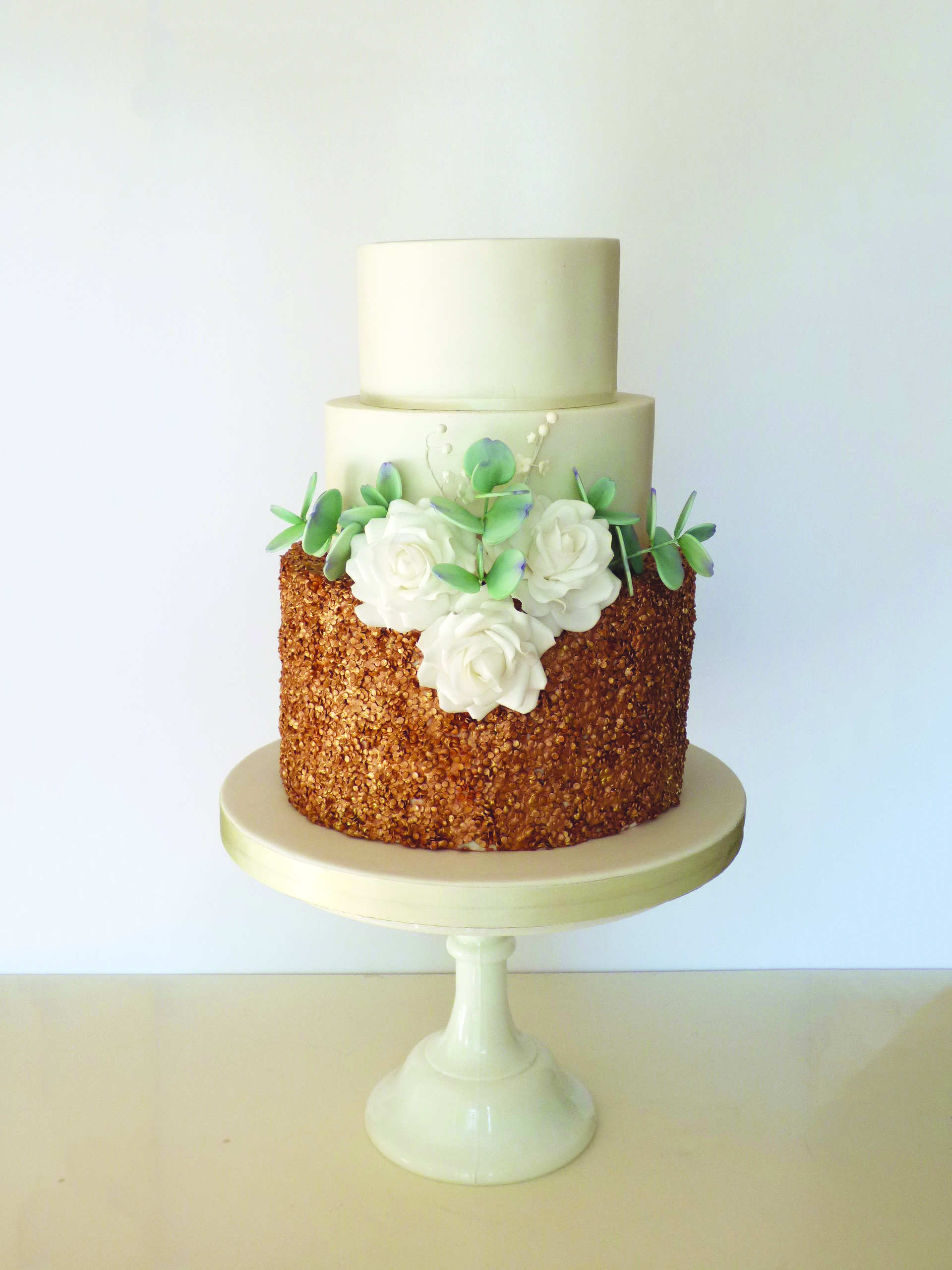 Sequins and sugar flowers on this beautiful wedding cake at Pembroke Lodge in Richmond Park, London