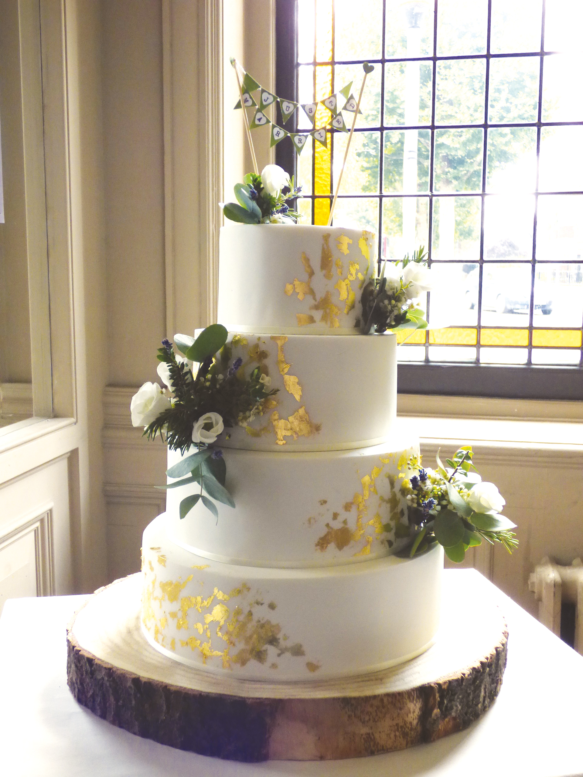 Wedding cake with rustic gold flakes