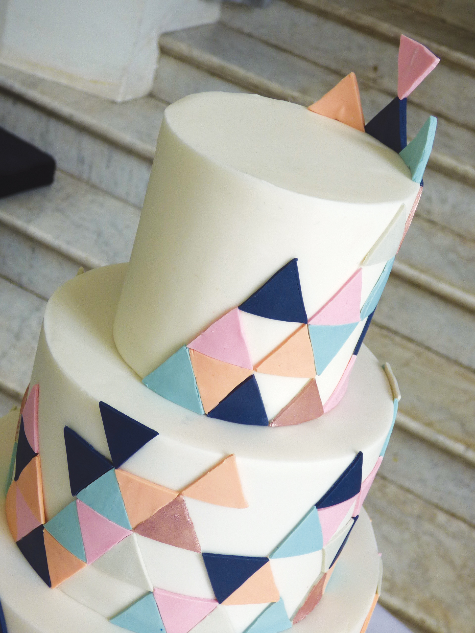 Wedding cake with funky geometric triangles in different colours