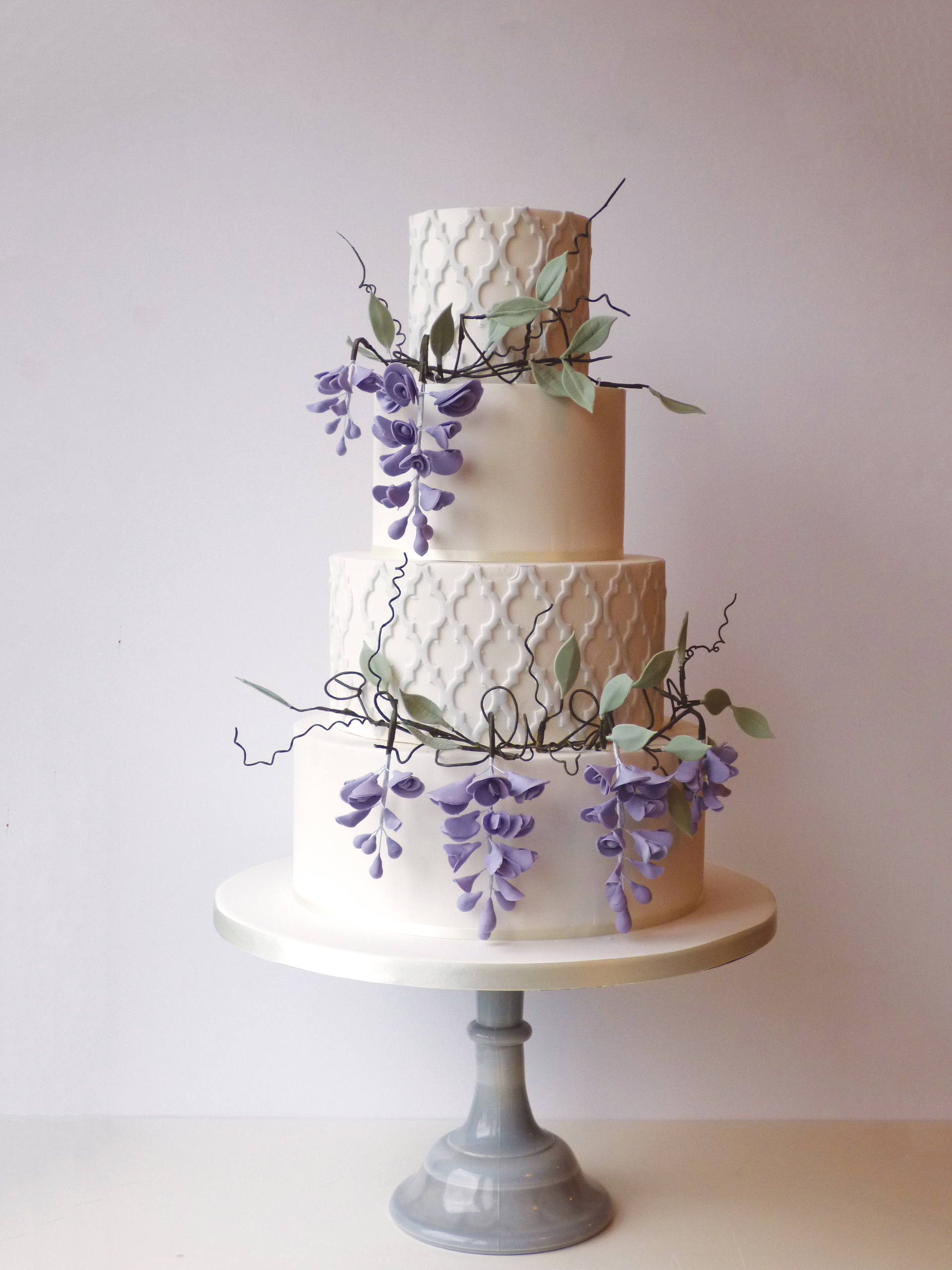 Whimsical Wisteria tumbling down this wedding cake makes it perfect for a venue like Pembroke Lodge, Chiswick House, Kew Gardens or Hampton Court Palace!