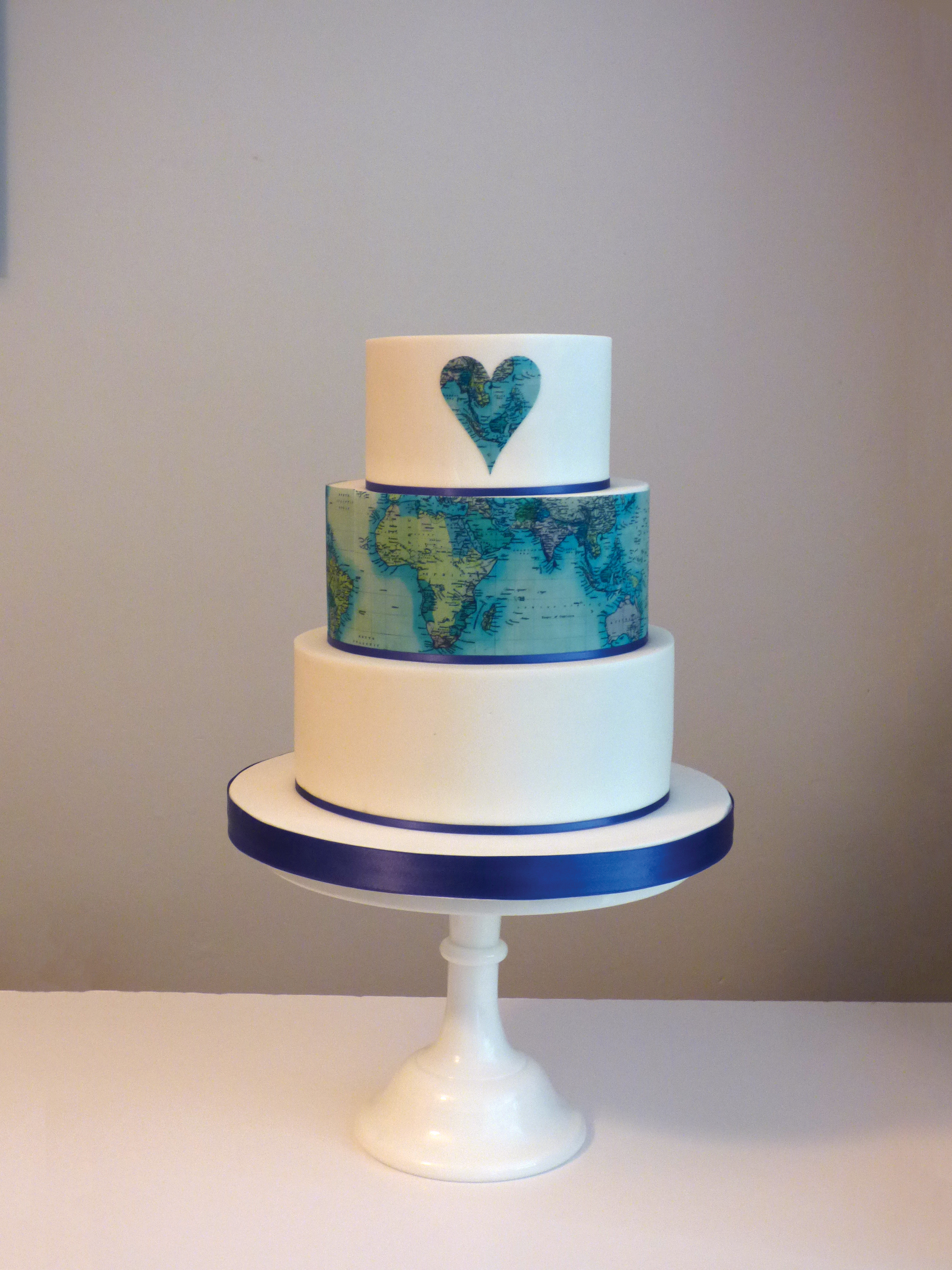 Vintage world map cake for a travel themed wedding