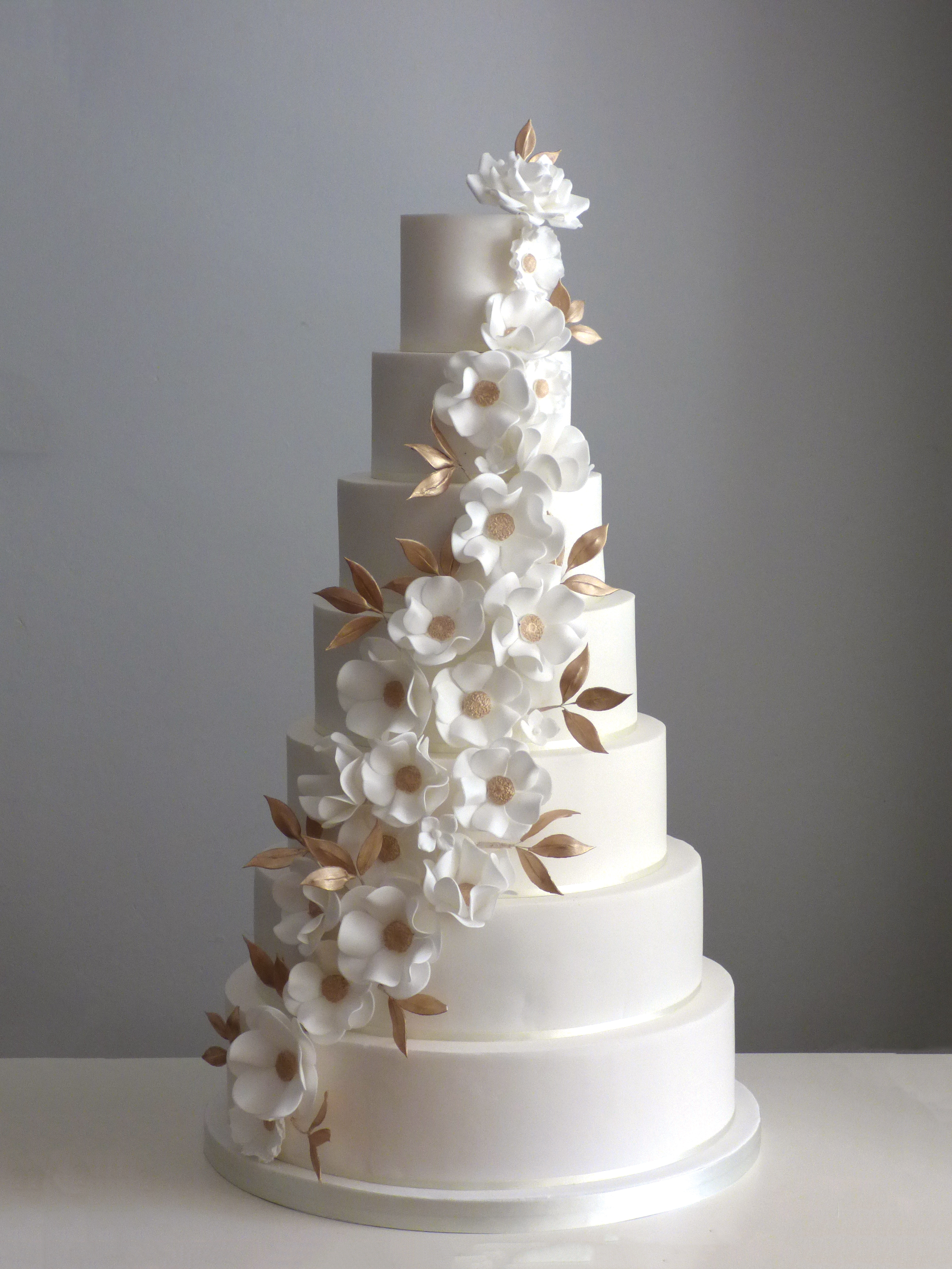 Cake with flowers and foliage - works for anything from an enchanted woodland theme to a traditional elegant wedding.