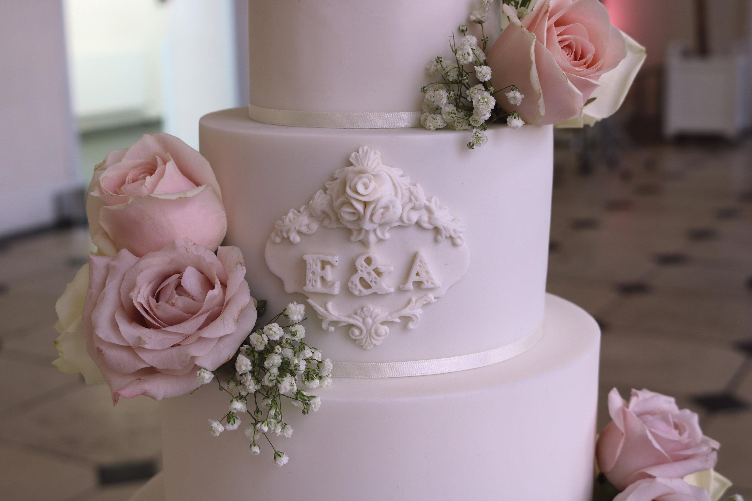 details of this elegant monogrammed wedding cake at Kew Gardens Orangery in West London