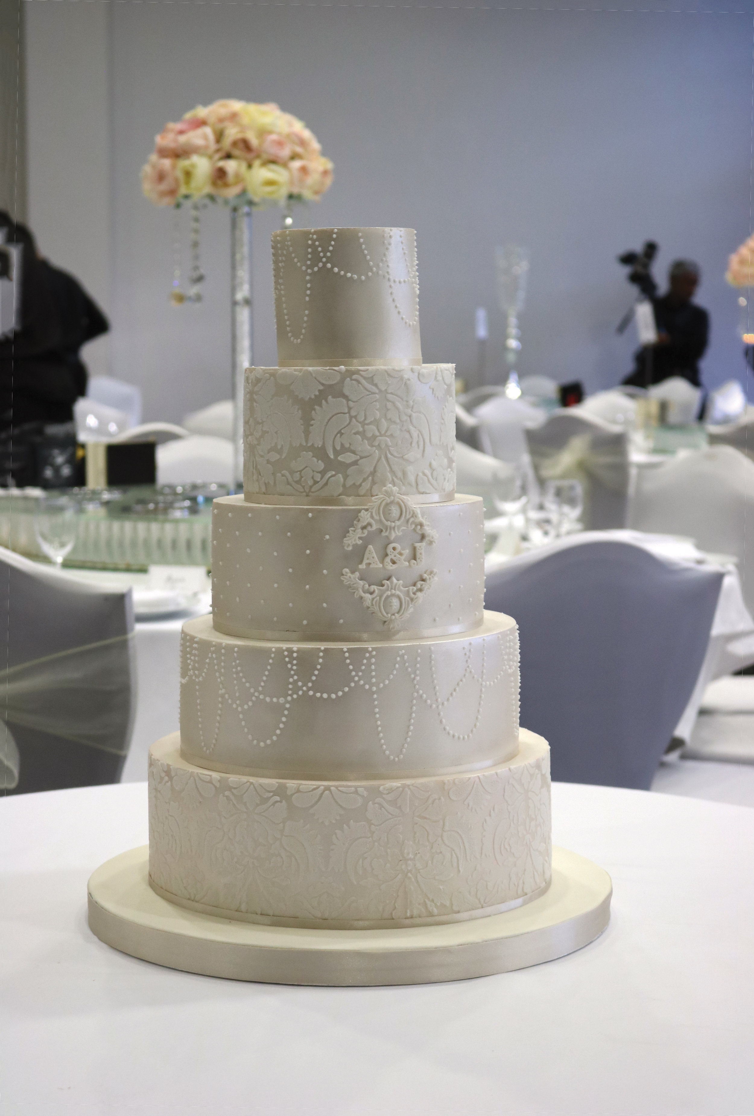 Satin lace wedding cake & monogram with pearl finish at for an asian wedding at Syon Hilton in Brentford, West London