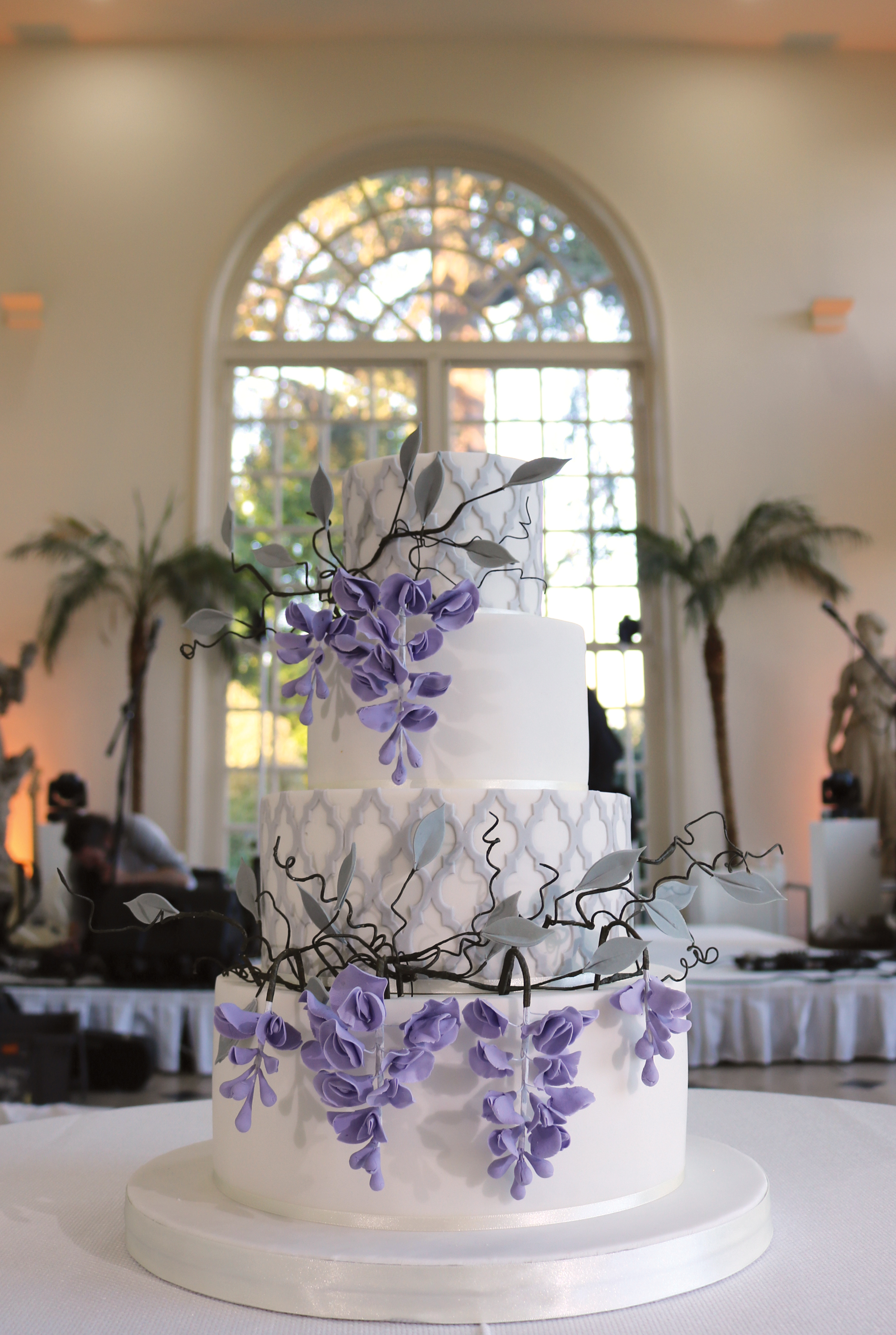 Wisteria winding around this wedding cake with grey lattice work, in position in the Orangery at Kew Gardens in West London.