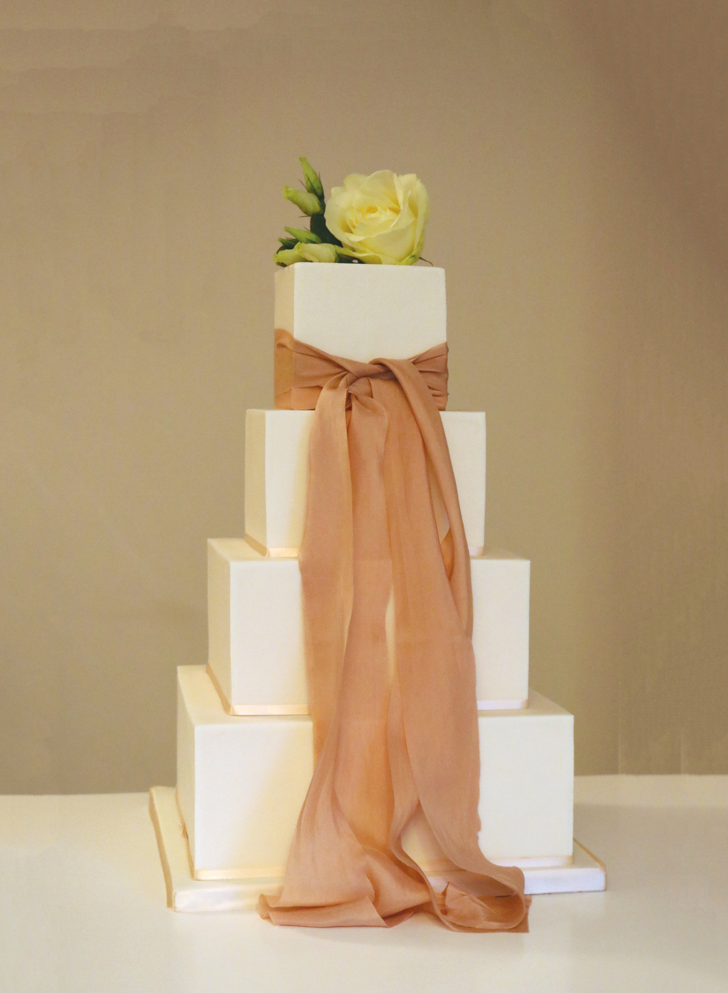 Wedding cake with classical finish and soft silk ribbon