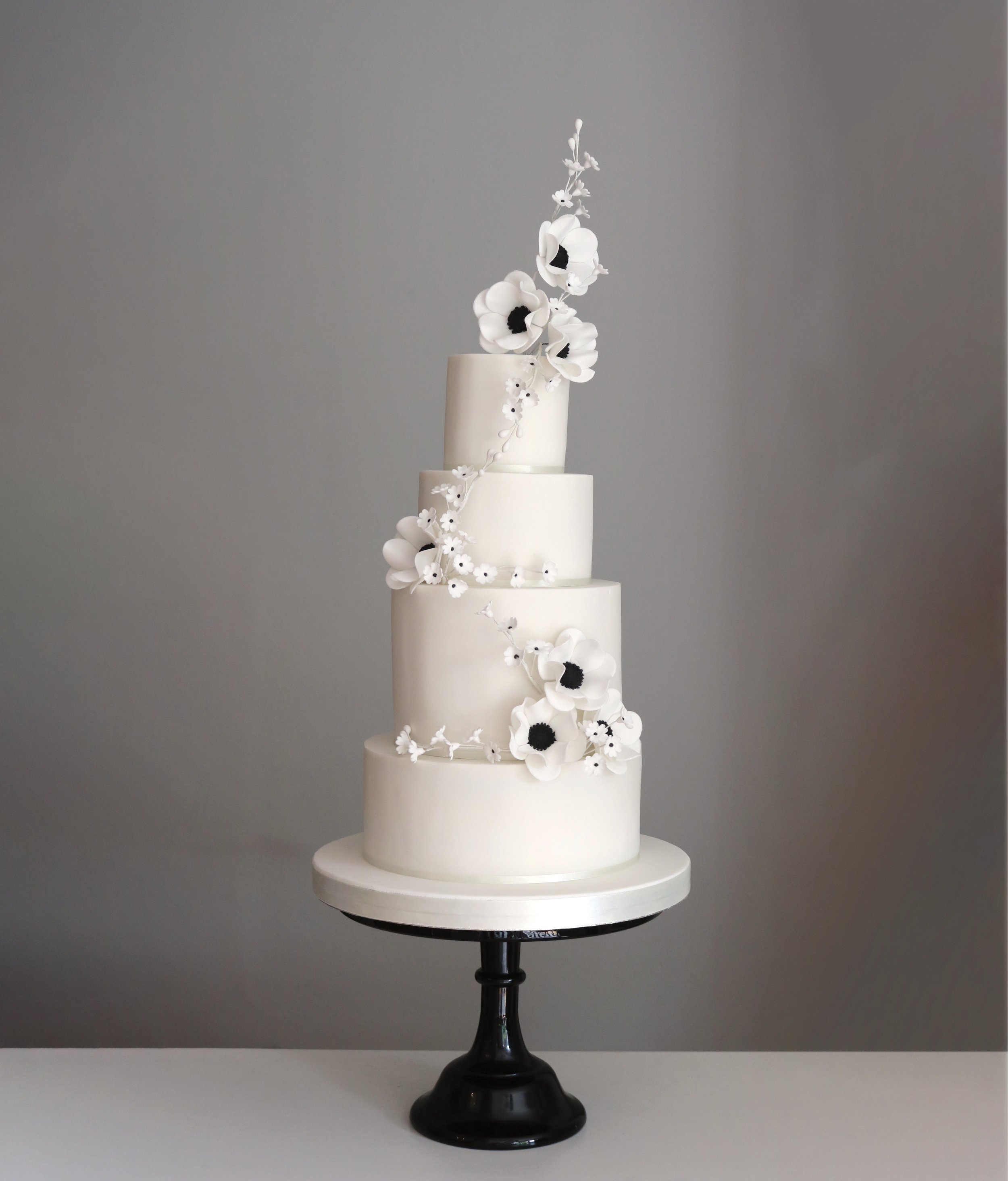 Wedding cake with marble tier and sugar flowers in blush.