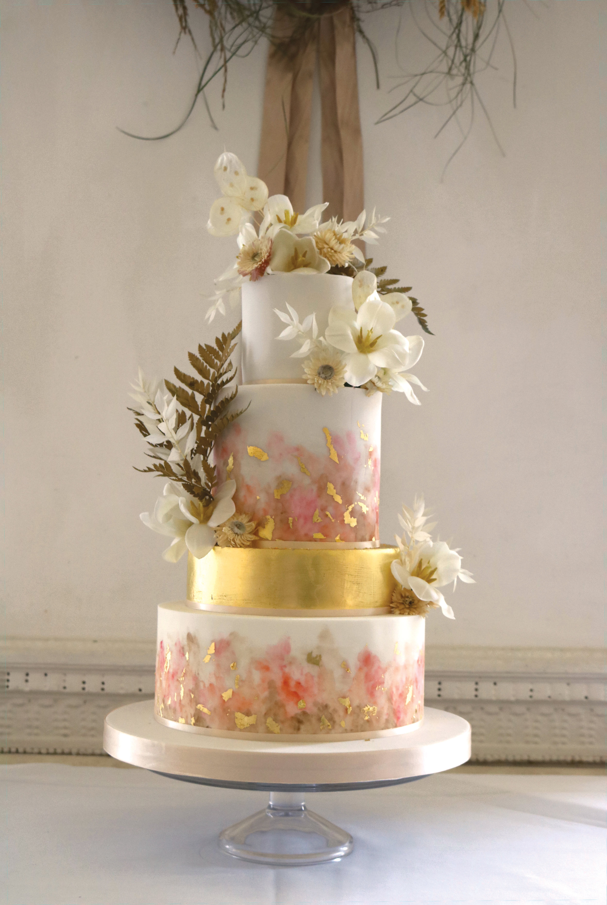 Wedding cake with nude, pink and biscuit painted watercolour effect and gold leaf