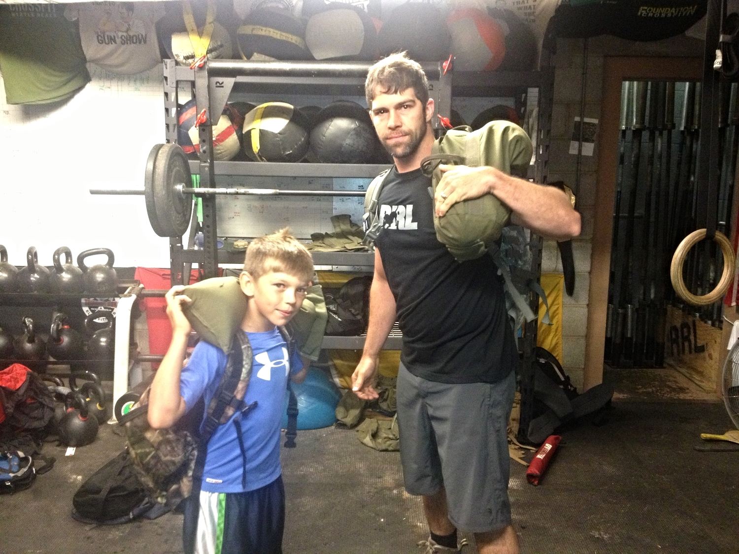 Great to have Trey back with us after his North Pacific trip. Yesterday, he brought his son, Grady.  This is how you scale a workout. Smaller ruck, smaller sandbag, same exercises. Good work Grady and Trey!