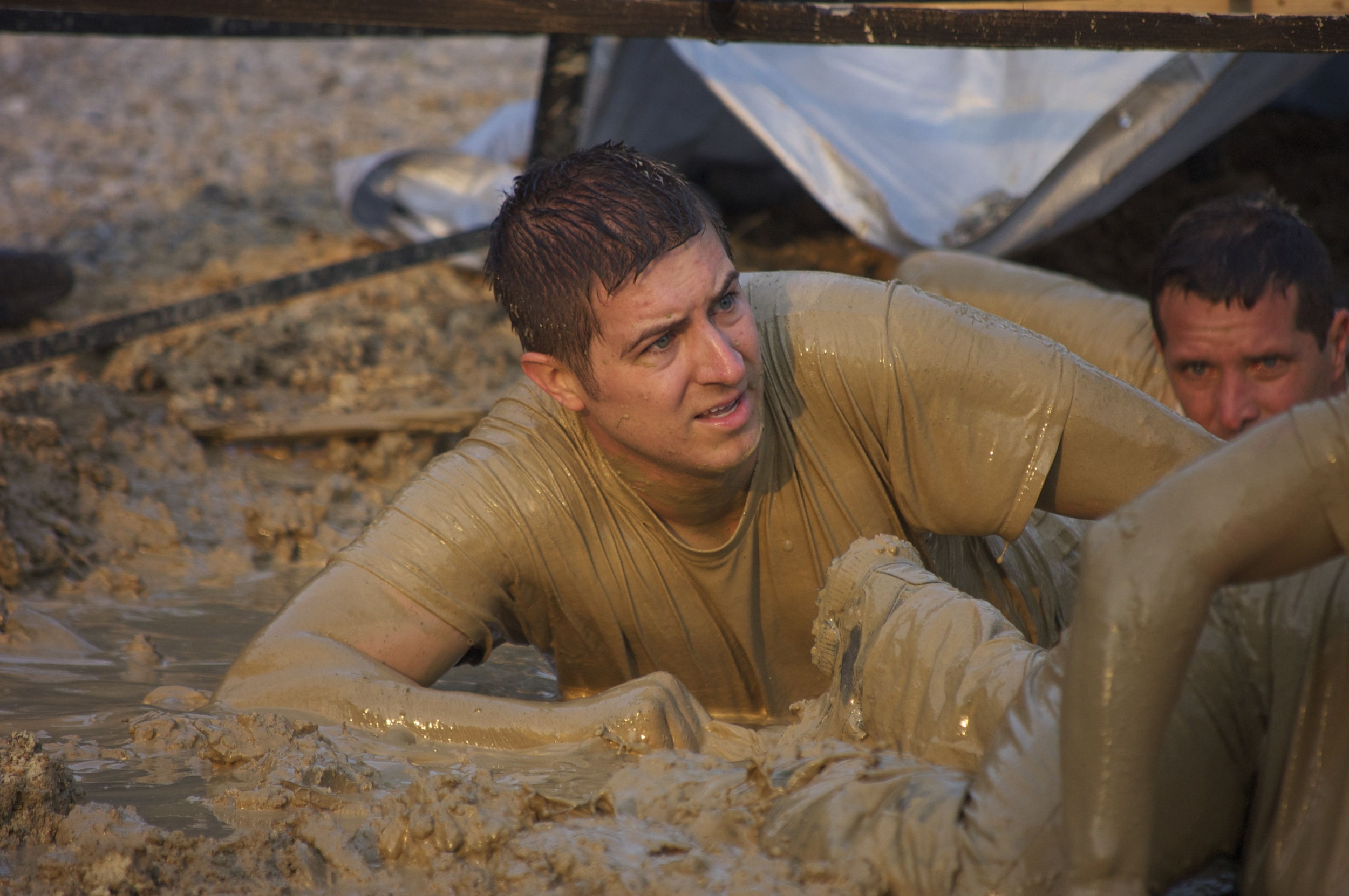 Jordan in the mud pit during the last few hours of SealFit 20x