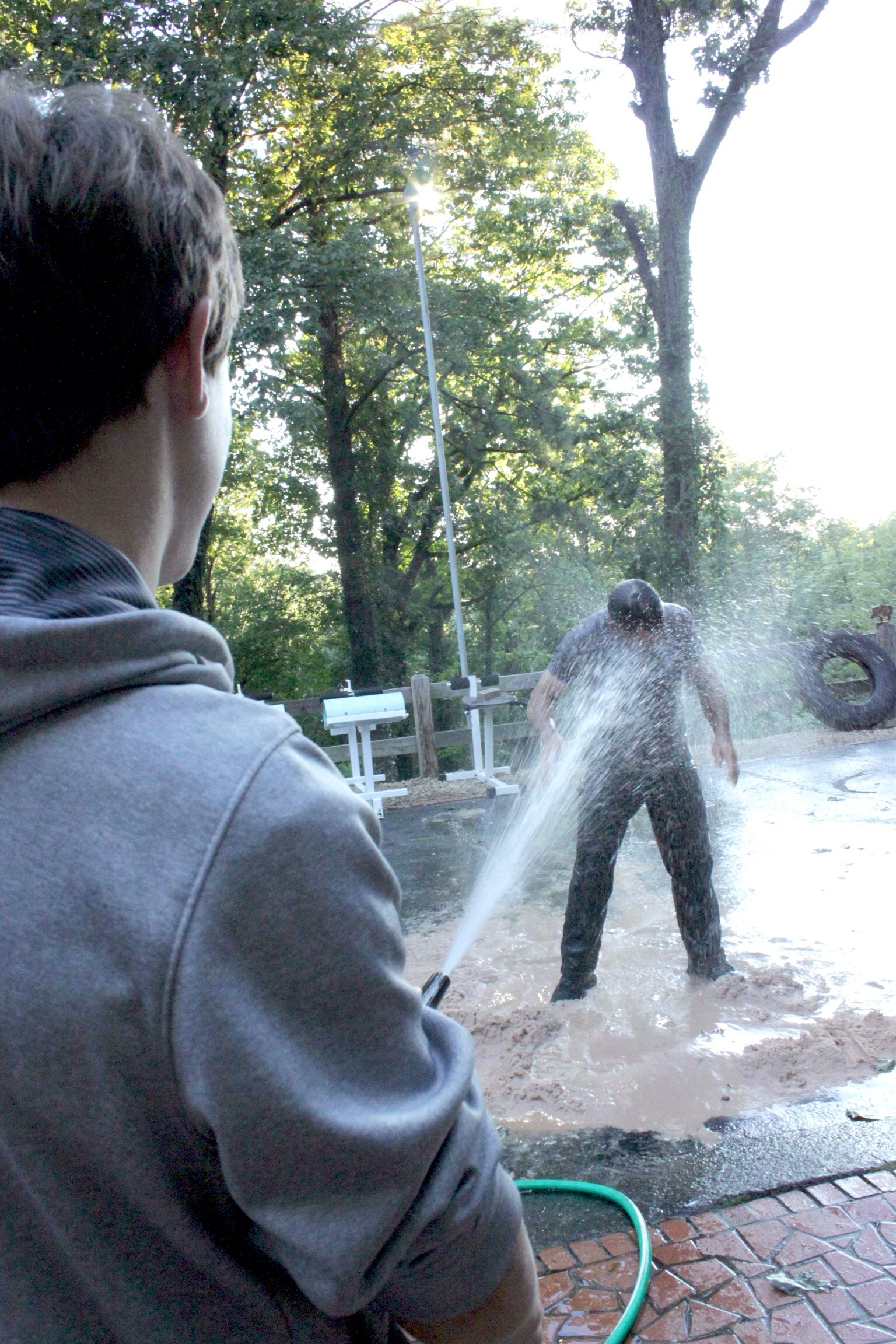 Hayden hits me with a hose during the 1000 burpee/5 mile Run-Burpee-Run workout