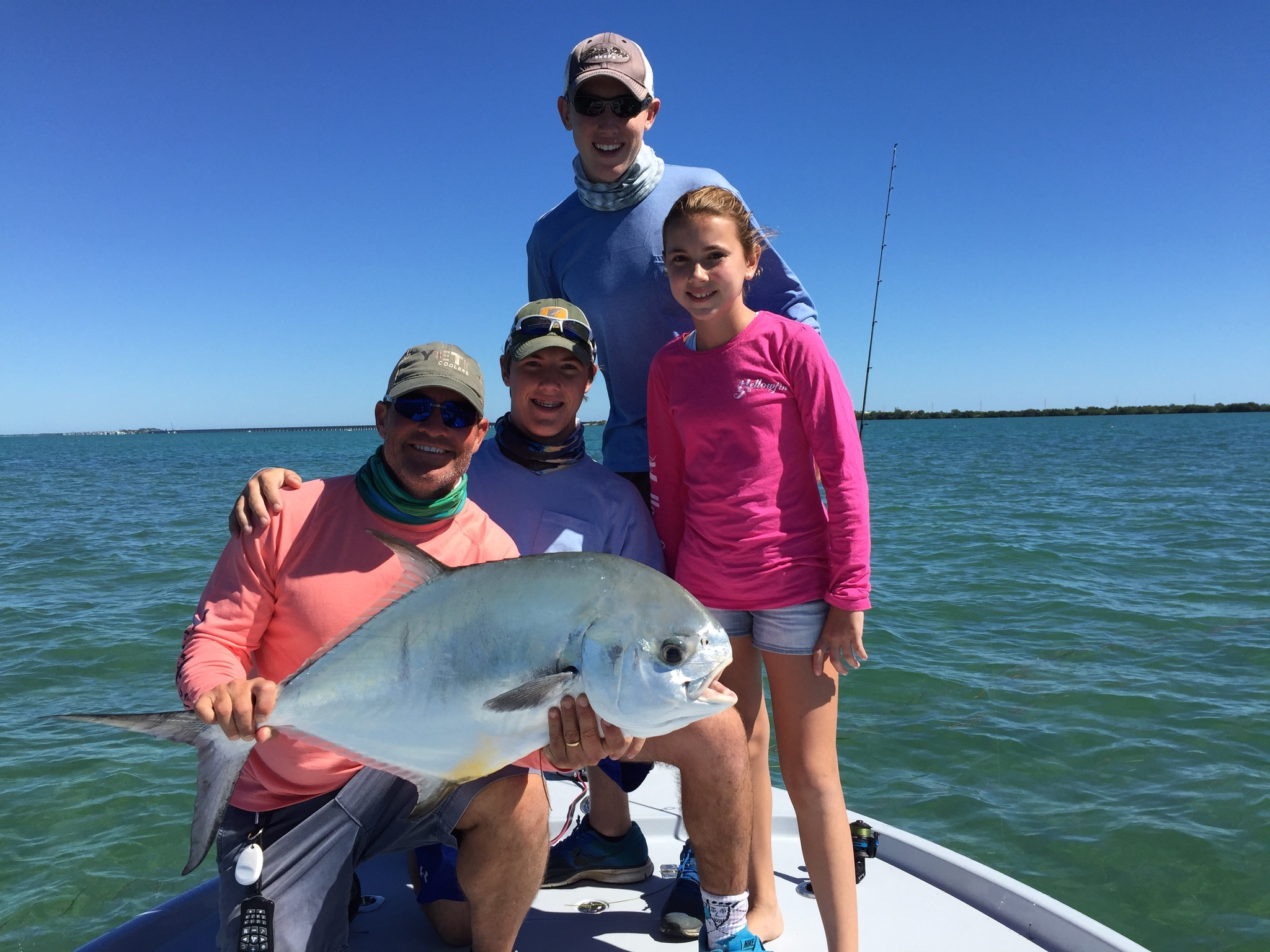Hayden caught this BEAUTIFUL Permit and my BEAUTIFUL wife got a picture of me, Turner, Hayden and Hanna with it!