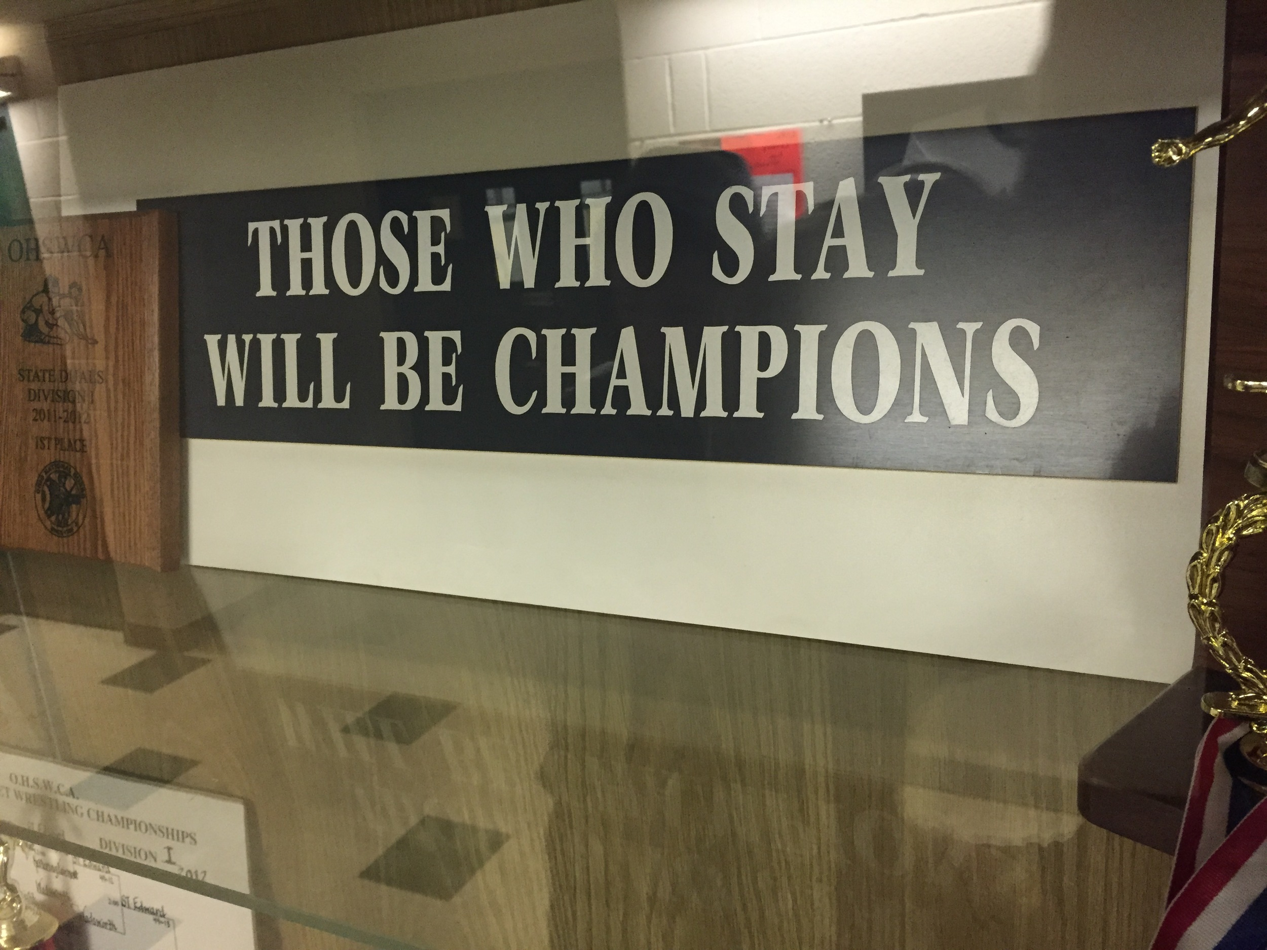 A sign I saw at St Edwards wrestling room.  Mediocrity is not tolerated there.